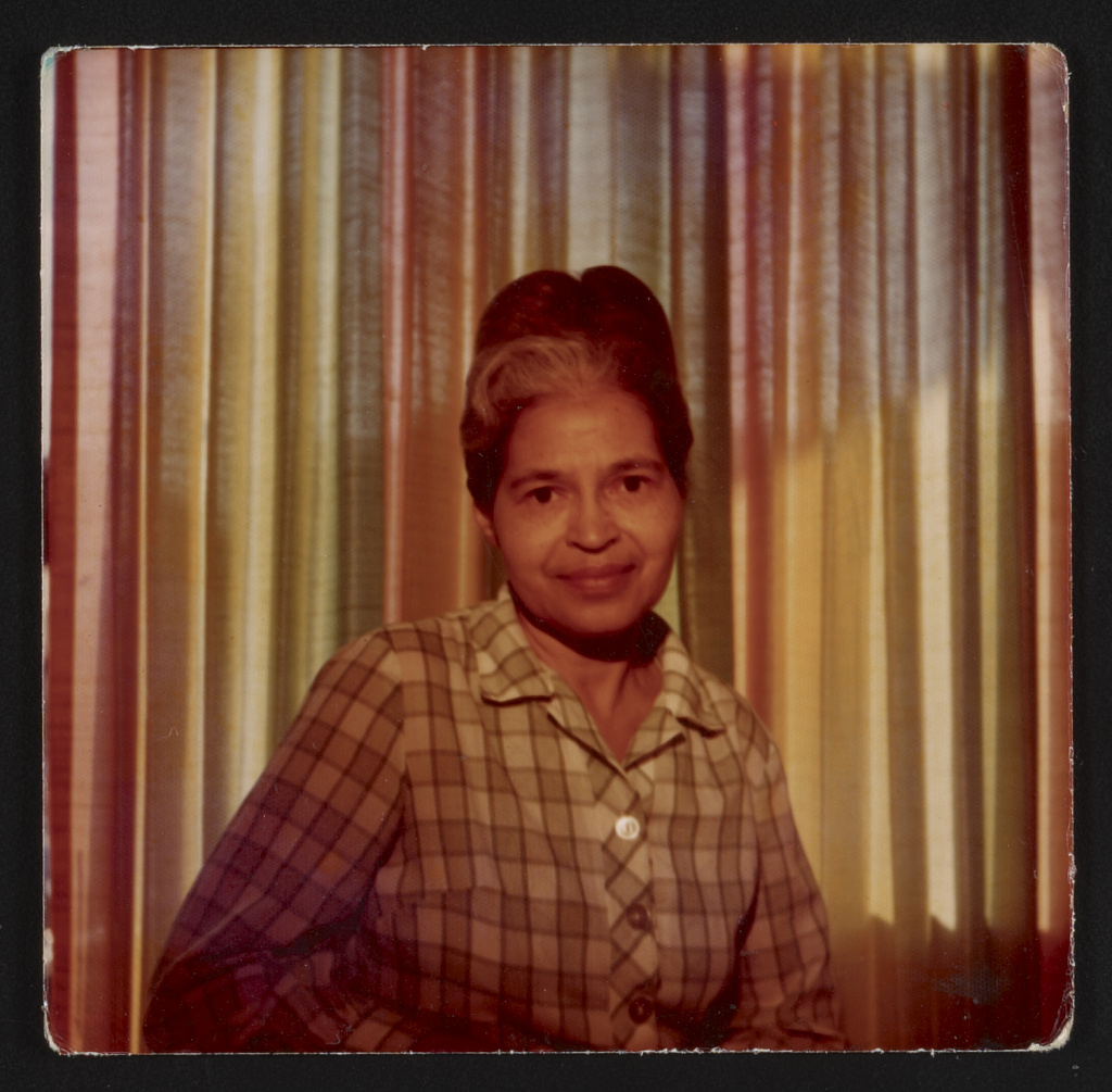 Photograph shows a half-length portrait of Rosa Parks, taken at the House of Beauty salon, Detroit, Michigan.