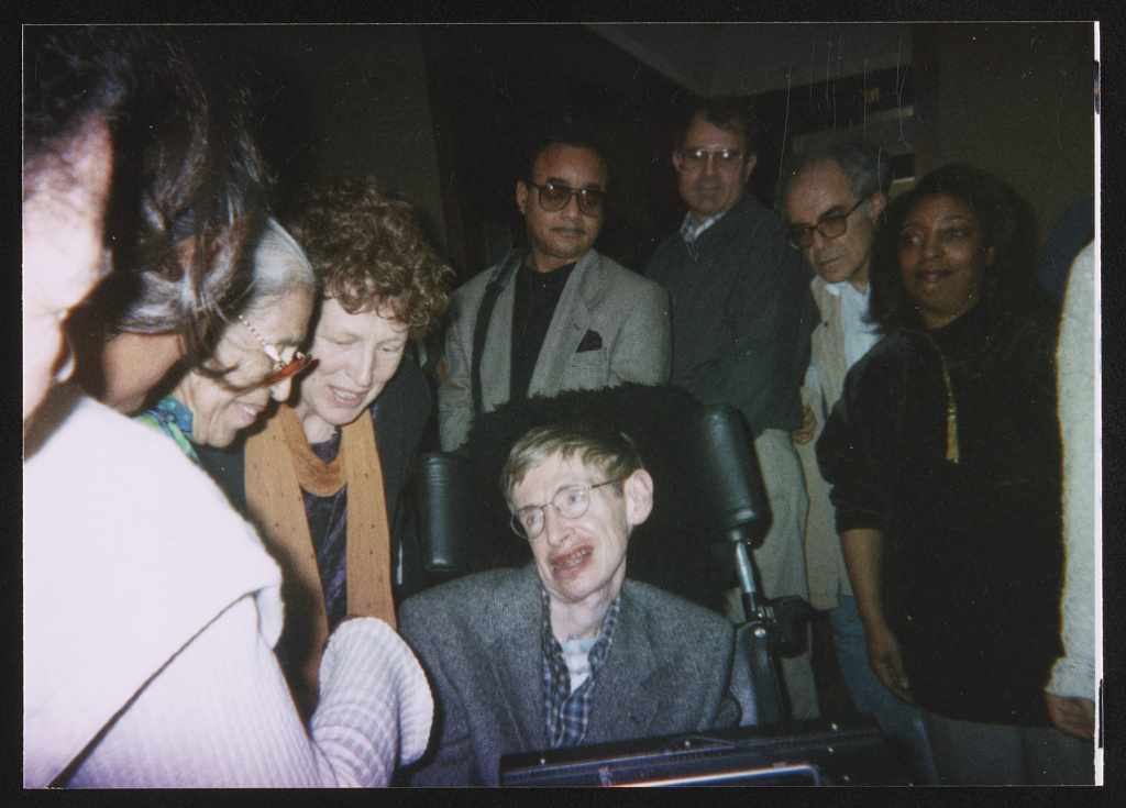 Physicist Stephen Hawking, Rosa Parks and others at an event 1990