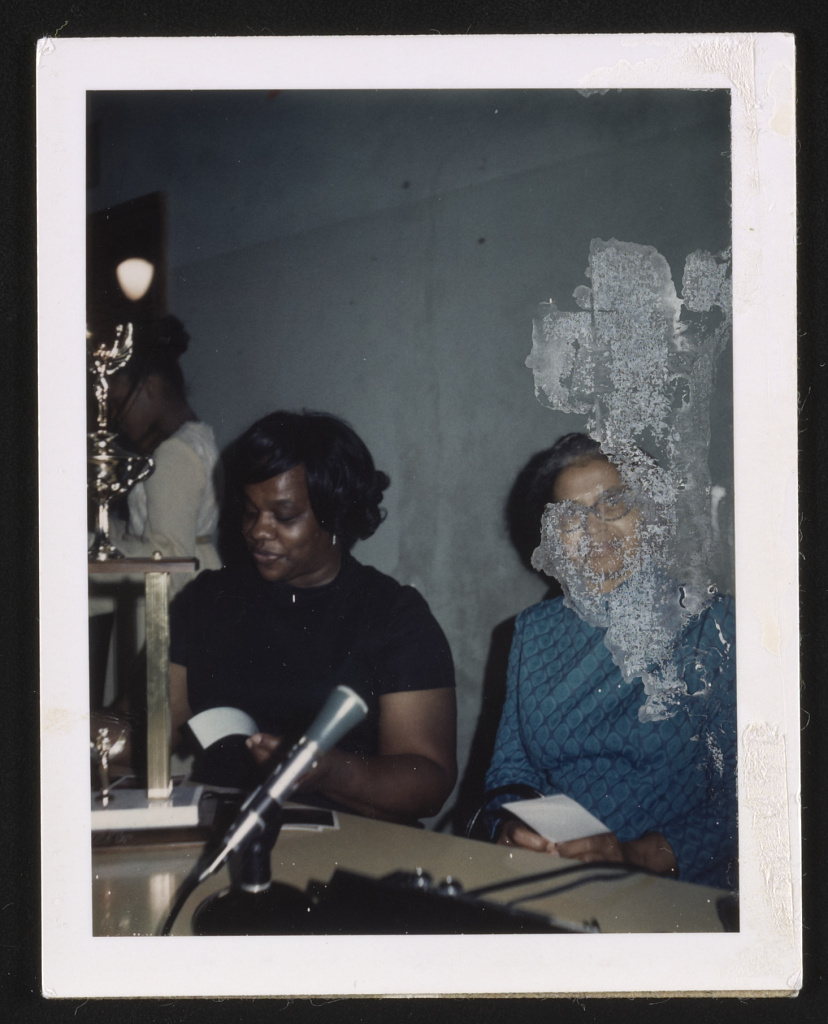 Rosa Parks sitting near a microphone at an unidentified event, 1970
