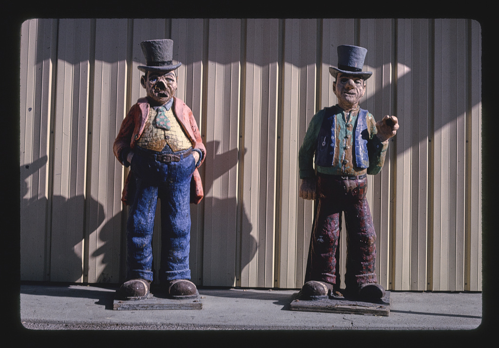Two Stiffs Selling Gas detail (two statues) 1981