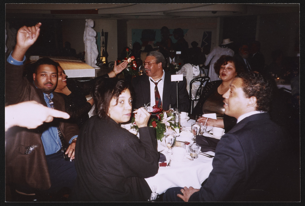 Rosa Parks' extended family seated around table 1995
