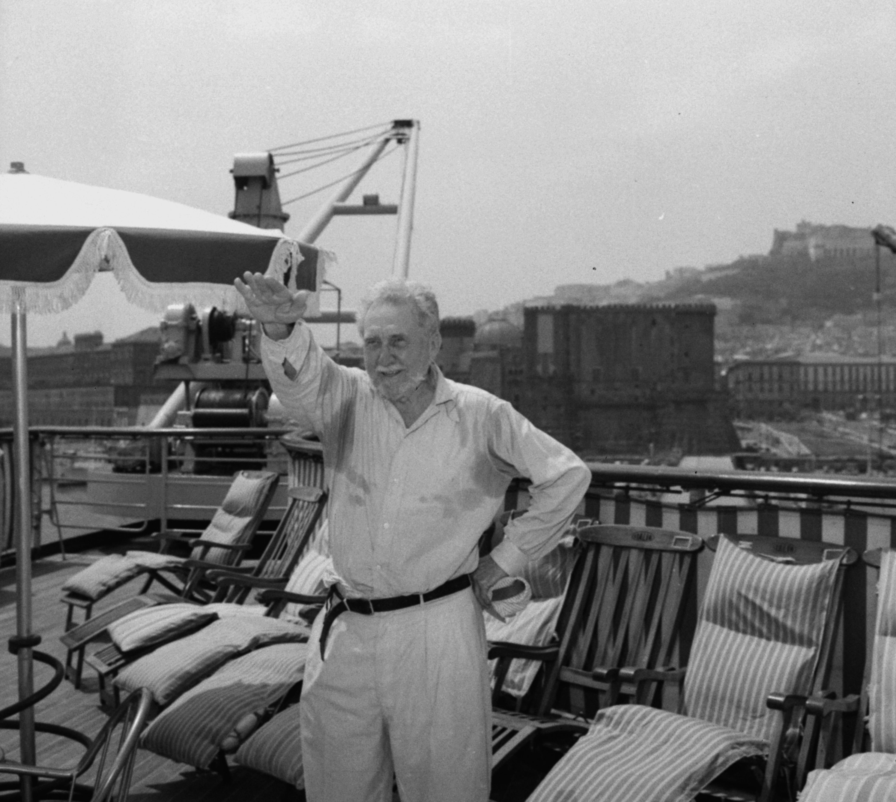 Poet Ezra Pound is pictured saluting in Fascist style on the deck of the liner Christoforo Colombo on arrival in Naples, Italy, . Pound, 72, plans to live in northern Italy with his daughter, Mary, 32, the wife of Prince Boris De Rachewiltz. Pound was accused of treason because of broadcasts he made from Italy during World War II. He was returned to the U.S. in 1945, judged insane, and confined to a mental institution in Washington, D.C. until April of this year. July 9, 1958