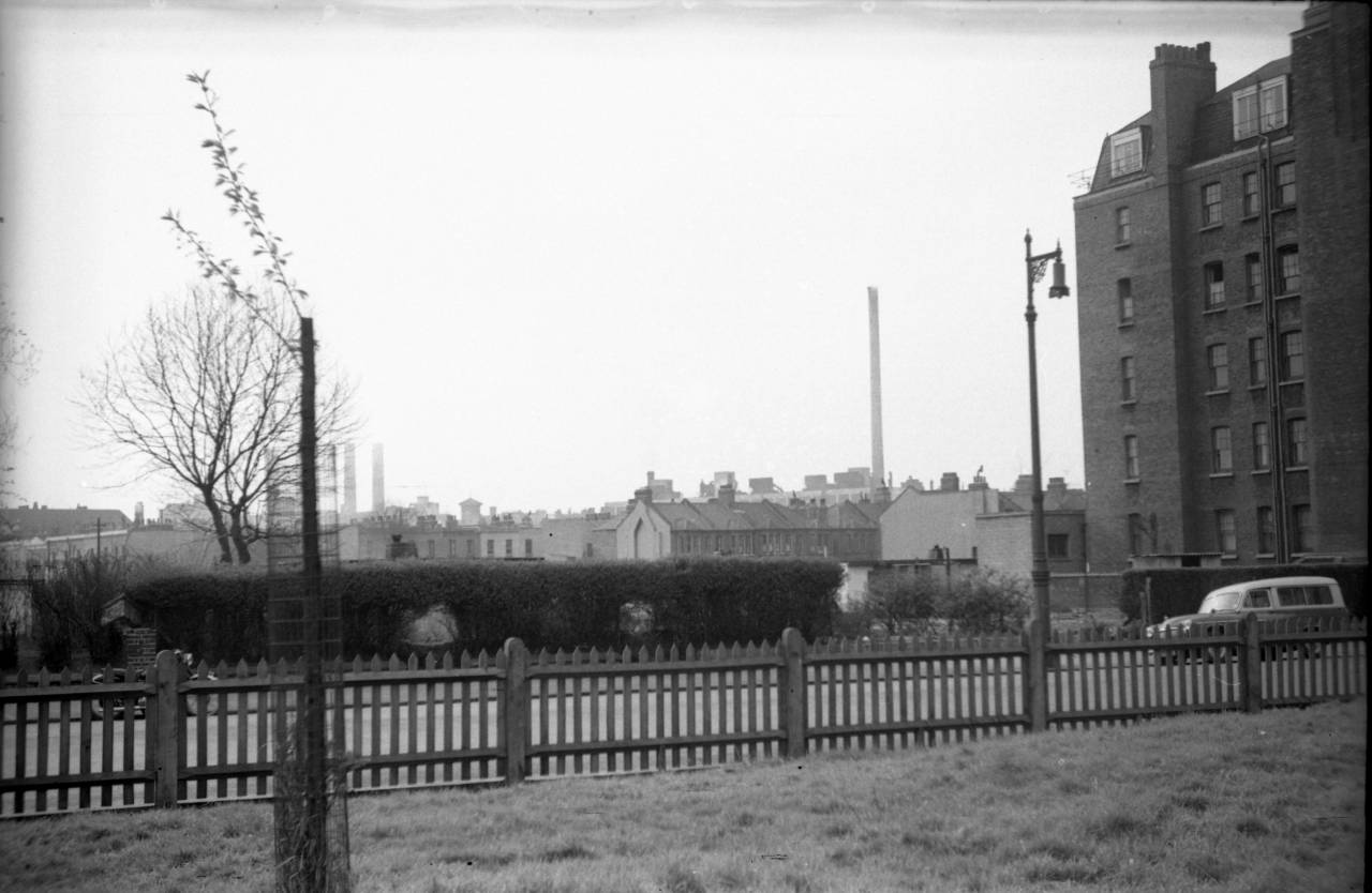 view from Battersea Park looking across Albert Bridge Road in the late 1950s, while the tall Morgan's Crucibles chimney prefab