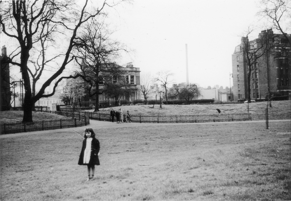 view from Battersea Park looking across Albert Bridge Road towards Ethelburga Street, which has subsequently disappeared in redevelopment. Morgan's tall chimney