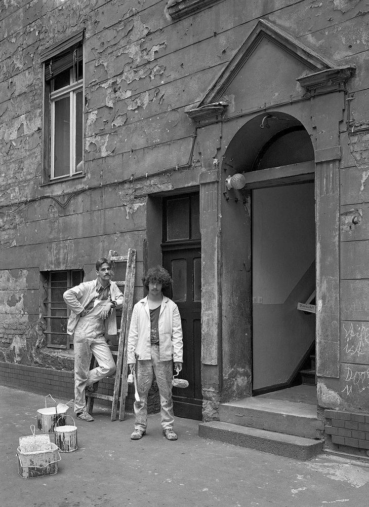 "Two painters from the cooperative ""Decorative Construction and Living"" finish painting the stairway entrance to my building, No. 31, 1987"