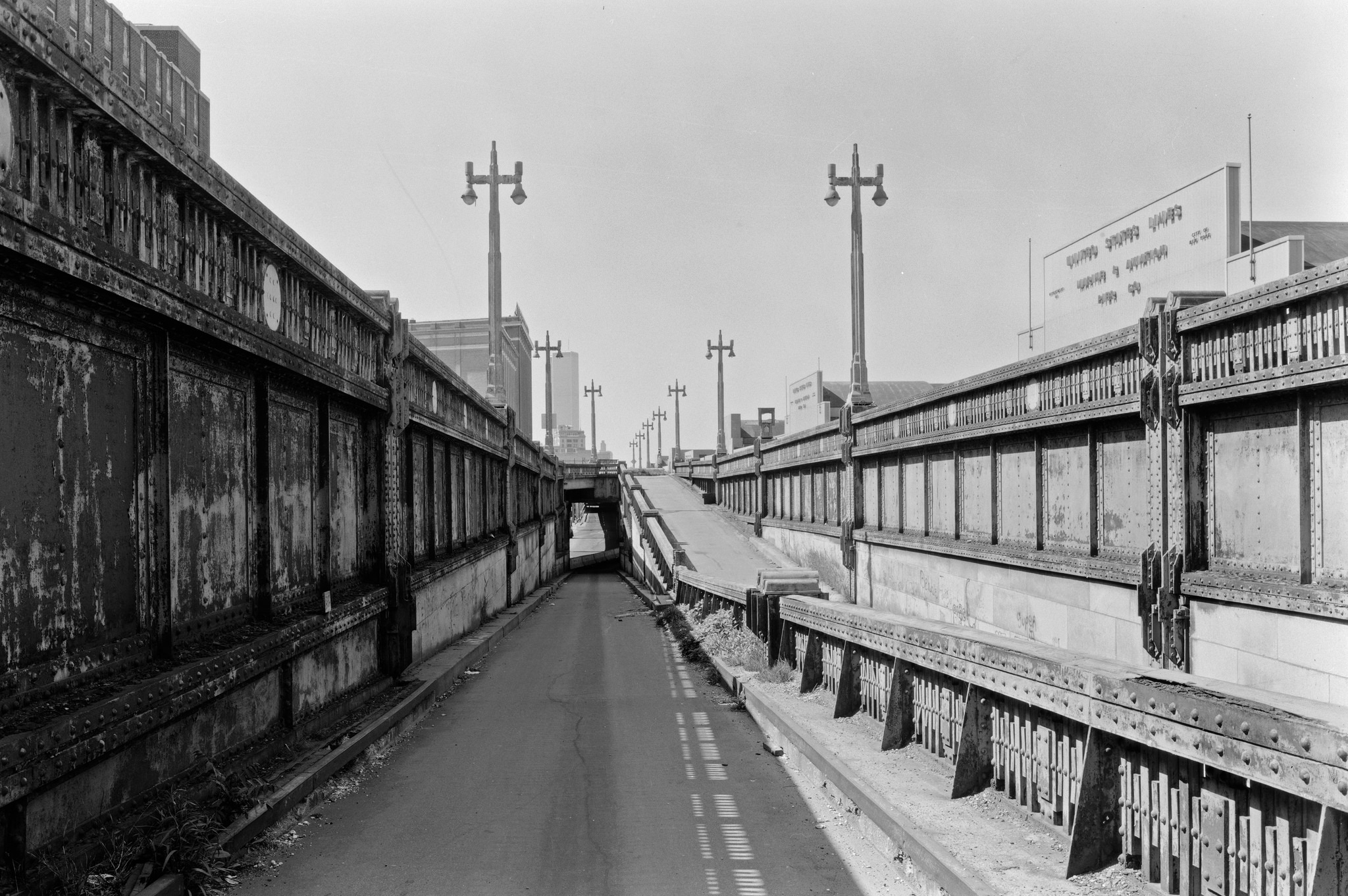 Abandoned West Side Highway ramps at 23rd Street looking south to the World Trade Center. Rust and Weeds. Sept 1979