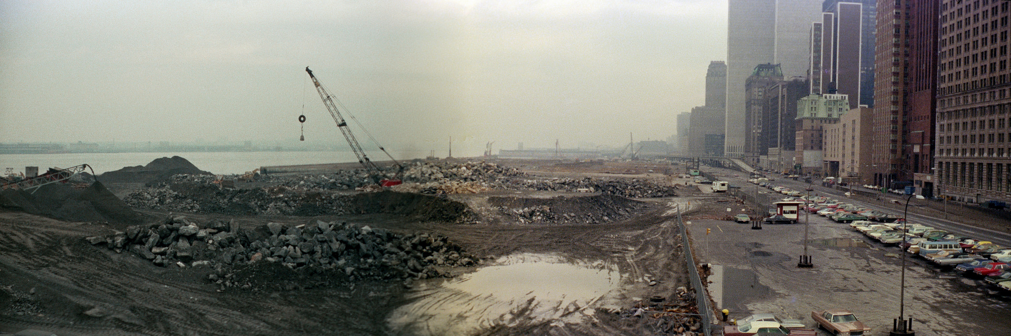 Battery Park City under construction, the very end of the abandoned West Side Highway, West Street and the World Trade Center on a rainy day in March 1975. New York.