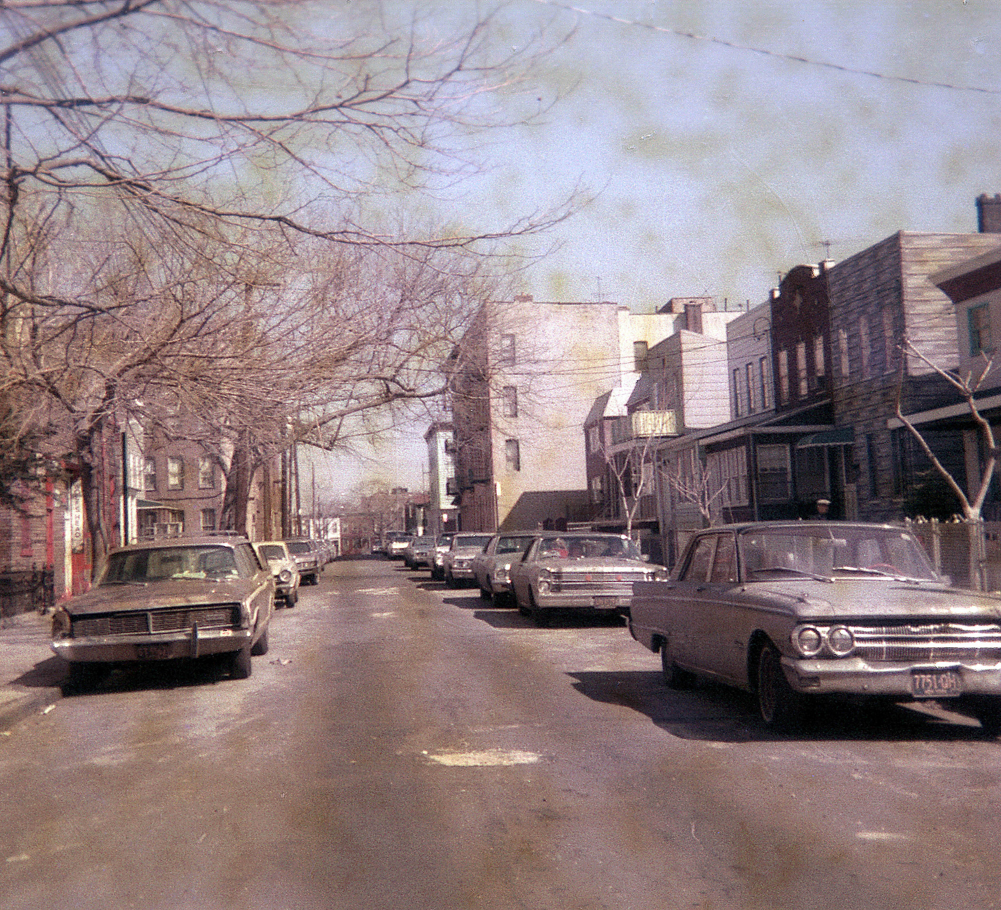 Cheap Triple Print 126 film showing battered 1960s cars in the East New York neighborhood of Brooklyn on McKinley Avenue. March 1972
