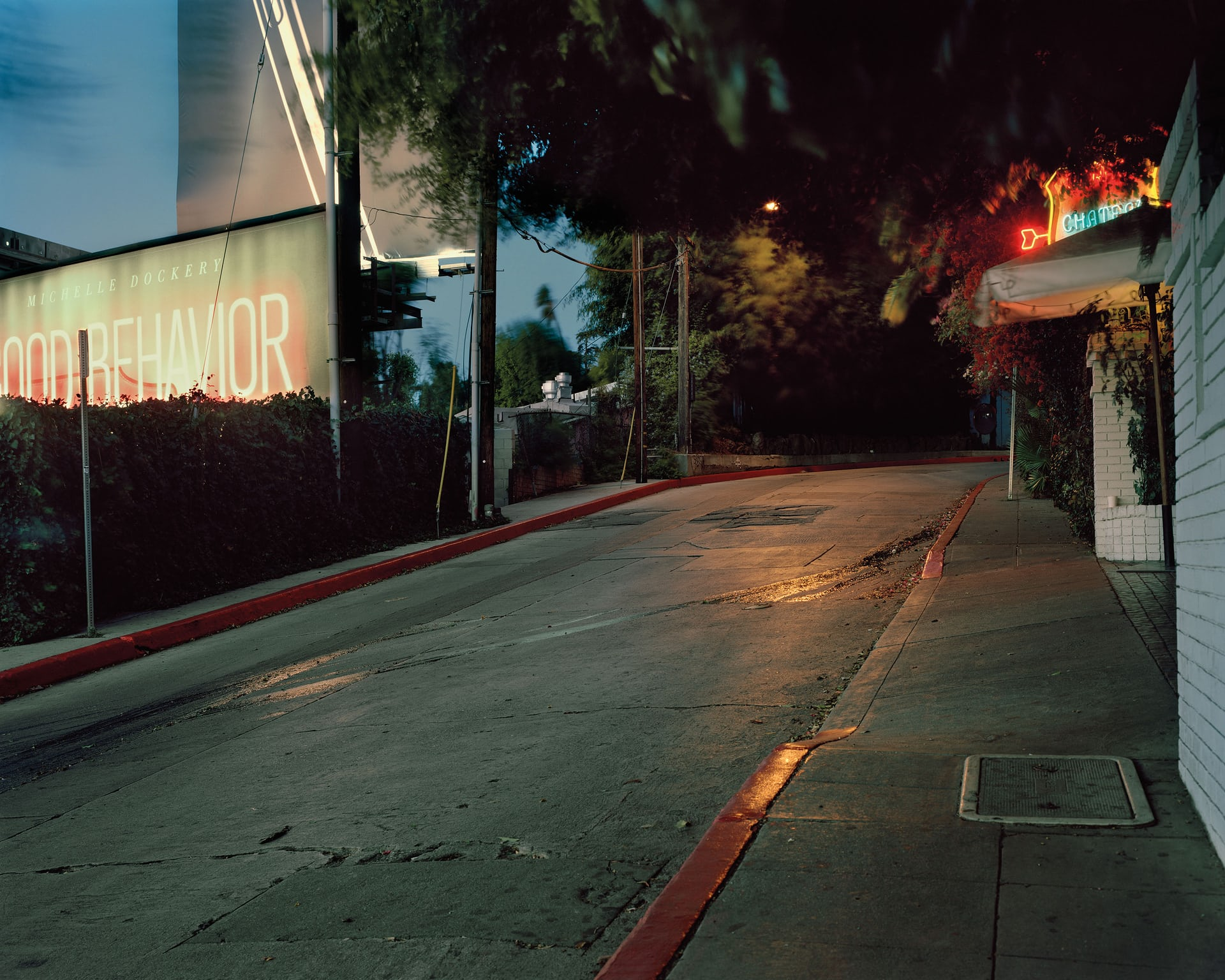 Helmut Newton, Marmont Lane, Los Angeles, 23 January 2004 The famous photographer's silver Cadillac SRX leaves the Chateau Marmont hotel at 11.40pm. His car first knocks over an Associated Press photographer, who is walking past, then crashes into a wall in front of the hotel. Newton dies a few hours later