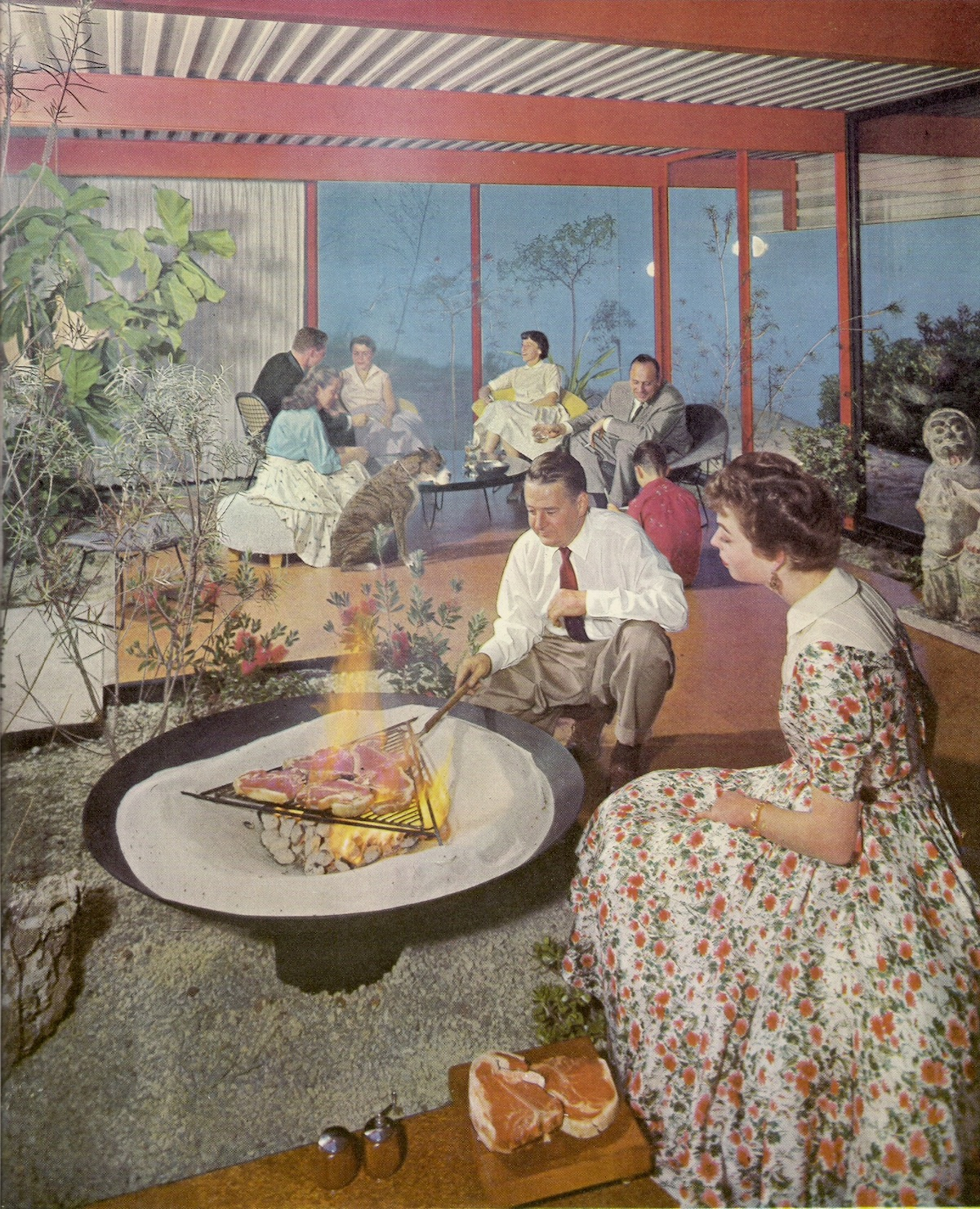 Architect Quincy Jones Barbeques Steak In The Living Room Of His Self-Designed House, 1958