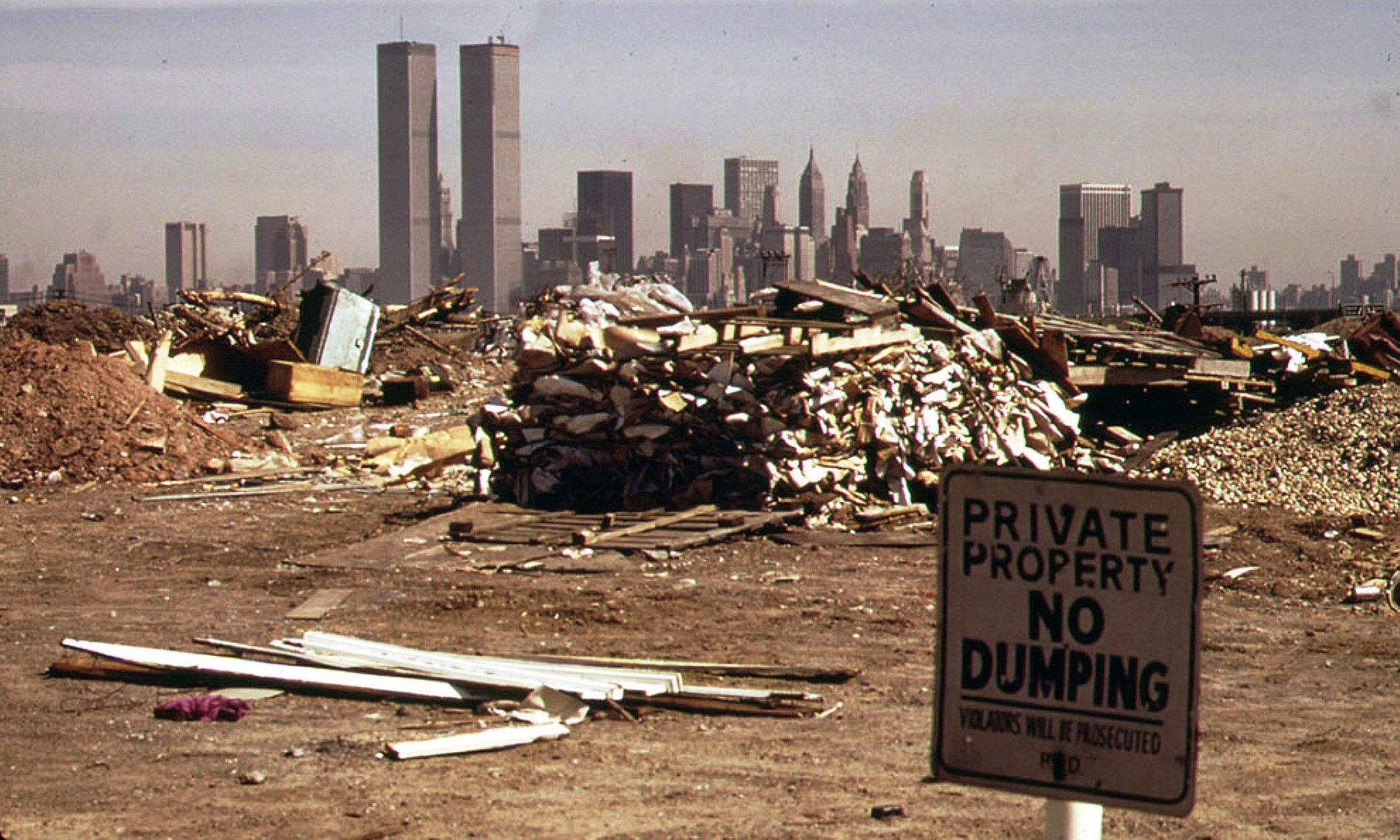 Looking east to Lower Manhattan and the World Trade Center from what is now the Grove of Remembrance, a fenced off overgown area that was too toxic to remediate. March 1974.