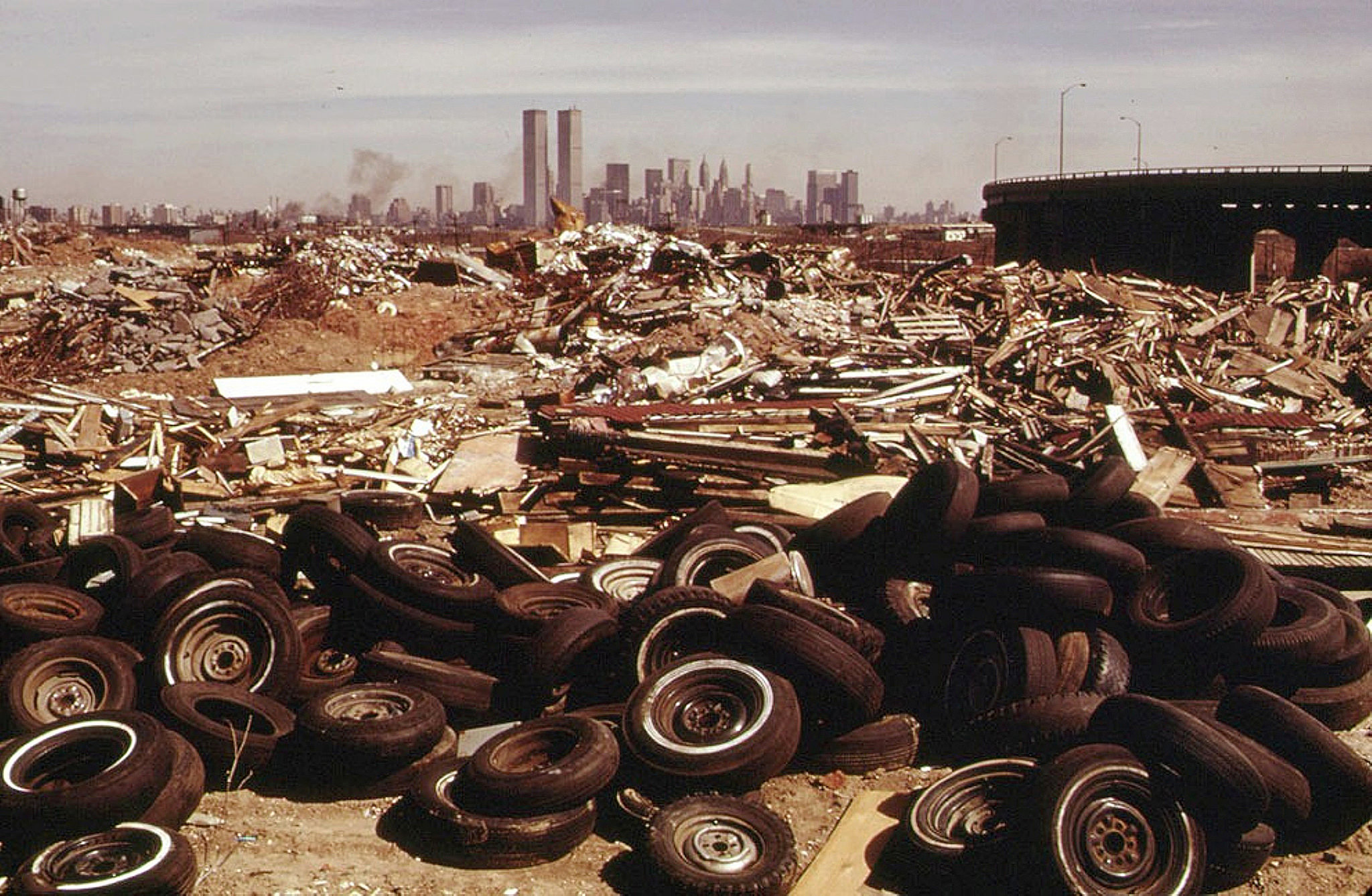 Looking east to Lower Manhattan and the World Trade Center near the New Jersey Turnpike exit 14B from James Hamil Drive. March 1974.