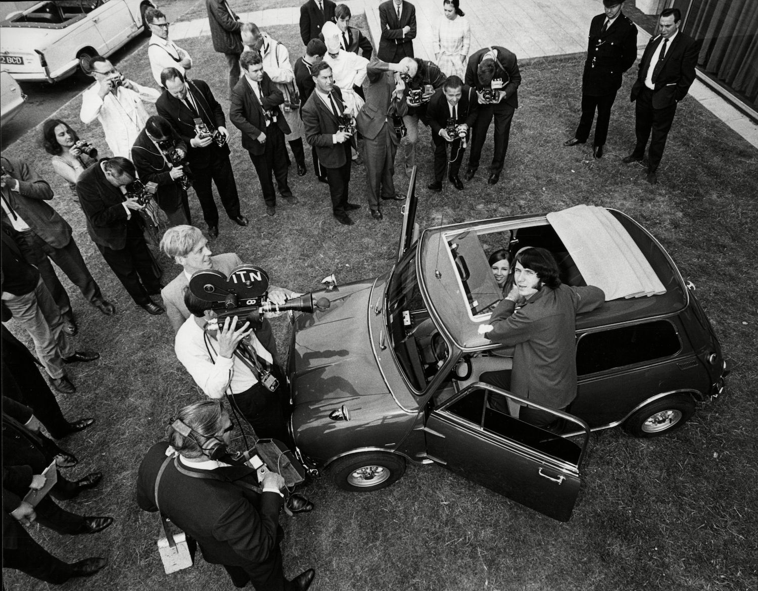 Mike Nesmith Of Pop Group The Monkees Here With His Wife Phyllis Nesmith And And His Mini Car Surrounded By Press 1967. 3 Jul 1967