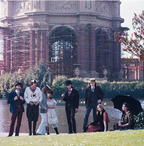 "The Charlatans and some of their ""old ladies,"" photographed at the Palace of Fine Arts in San Francisco by Herb Greene. From left to right: Mike Ferguson, Dan Hicks, George Hunter, Lucy Lewis, Mike Wilhelm, Richard Olsen, Susan Pilborough, and Carmella ""Candy"" Storniola."