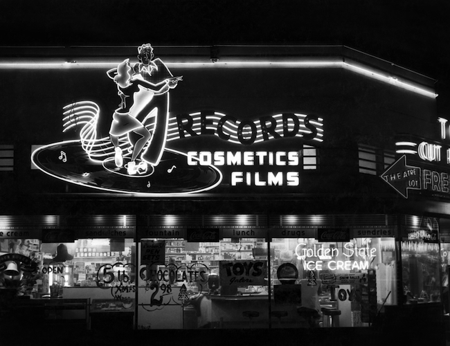 The neon sign advertising records and other items for sale at Russ Solomon's father's Sacramento drugstore. (Image courtesy Gravitas Ventures)
