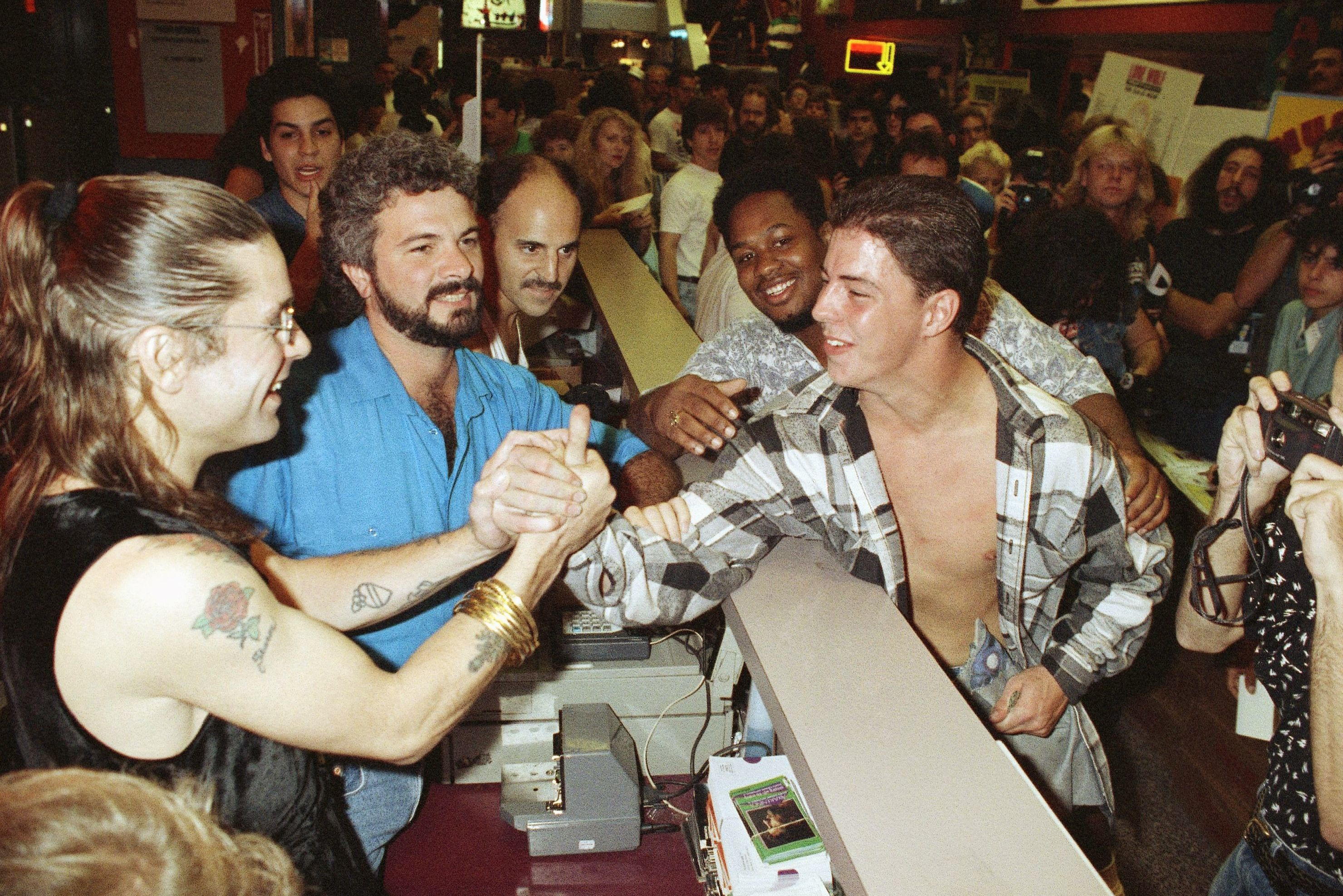 "Rocker Ozzy Osbourne greets fans at Tower Records in downtown Manhattan, New York, while kicking off the release of his new album ""No More Tears."" Osbourne surprised the crowd of some 200 people gathered at the store to purchase the long awaited Guns and Roses albums ""Illusion I"" and ""Illusion II"" which went on sale at midnight 17 Sep 1991"