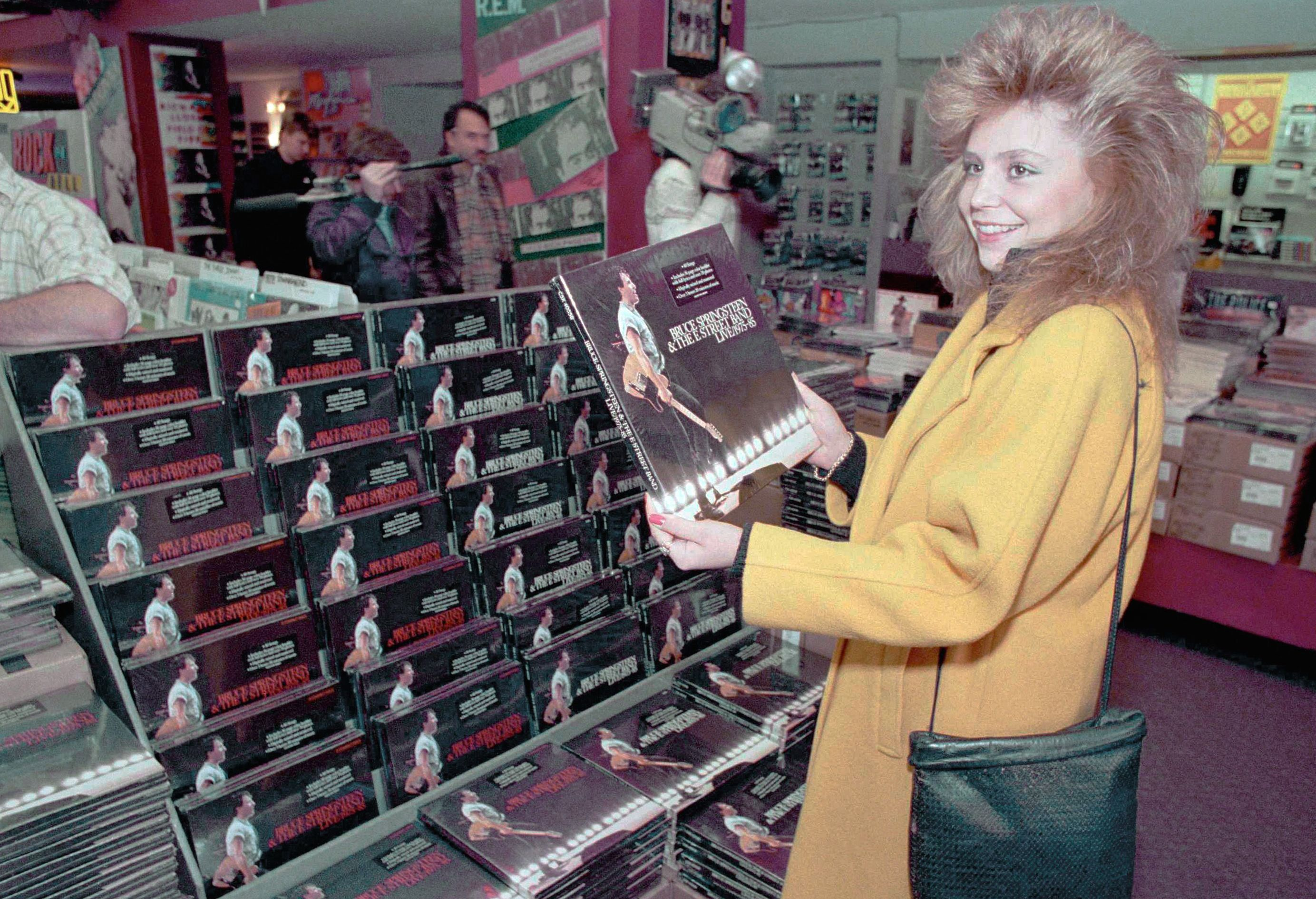 "Missy Coltenback of Secaucus, N.J. holds the five-record album set by rock singer Bruce Springsteen as it went on sale at Tower Records in New York, . Entitled ""Bruce Springsteen & the E Street Band Live--1975-85,"" the 40-song set is expected to set record sales 10 Nov 1986"