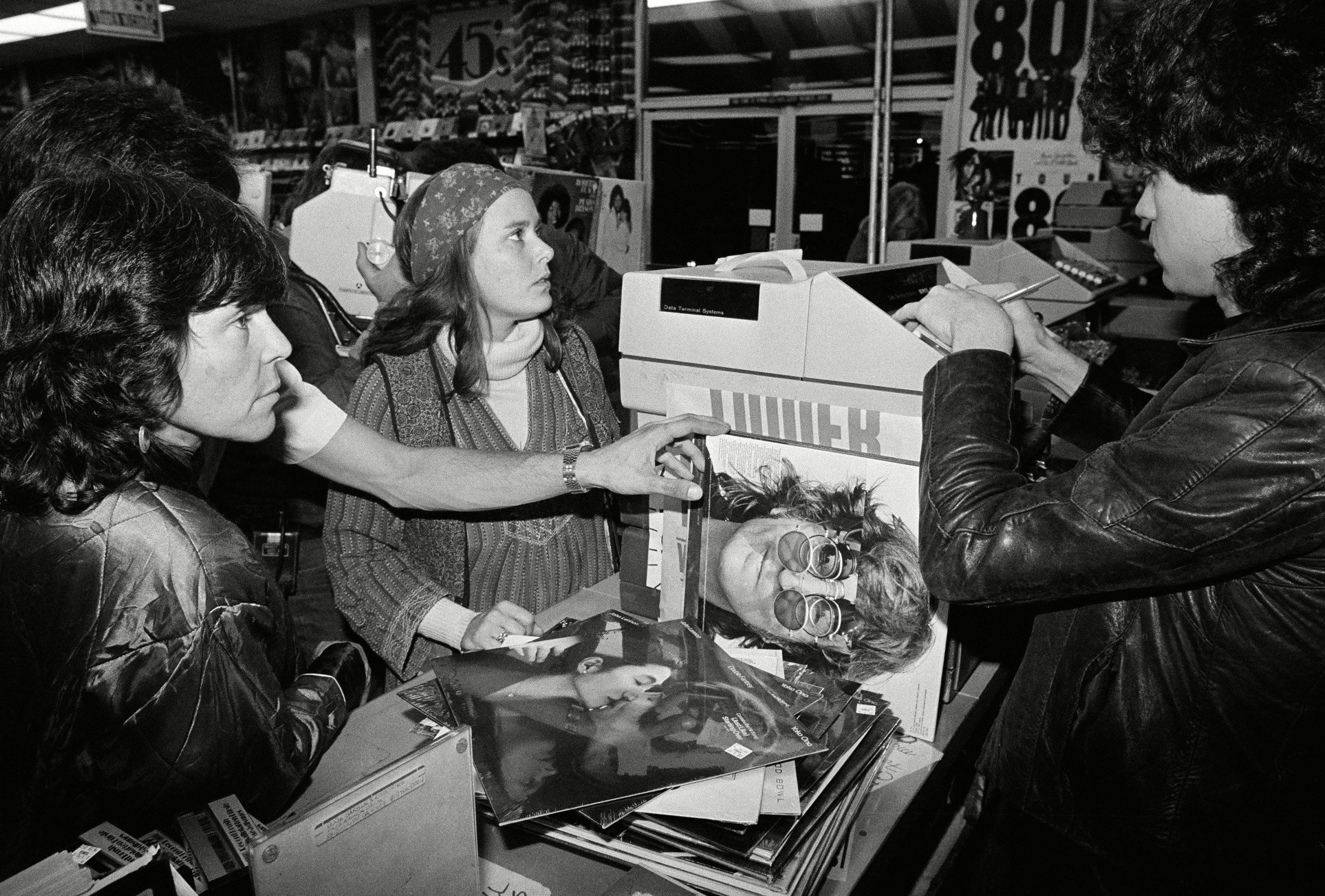 Kupferman Horowitz Lyn Kupferman, right, and her friend Shiela Horowitz wait as a Tower Records clerk rings up the purchase of over $200 in Beatles and John Lennon albums, in Los Angeles 8 Dec 1980
