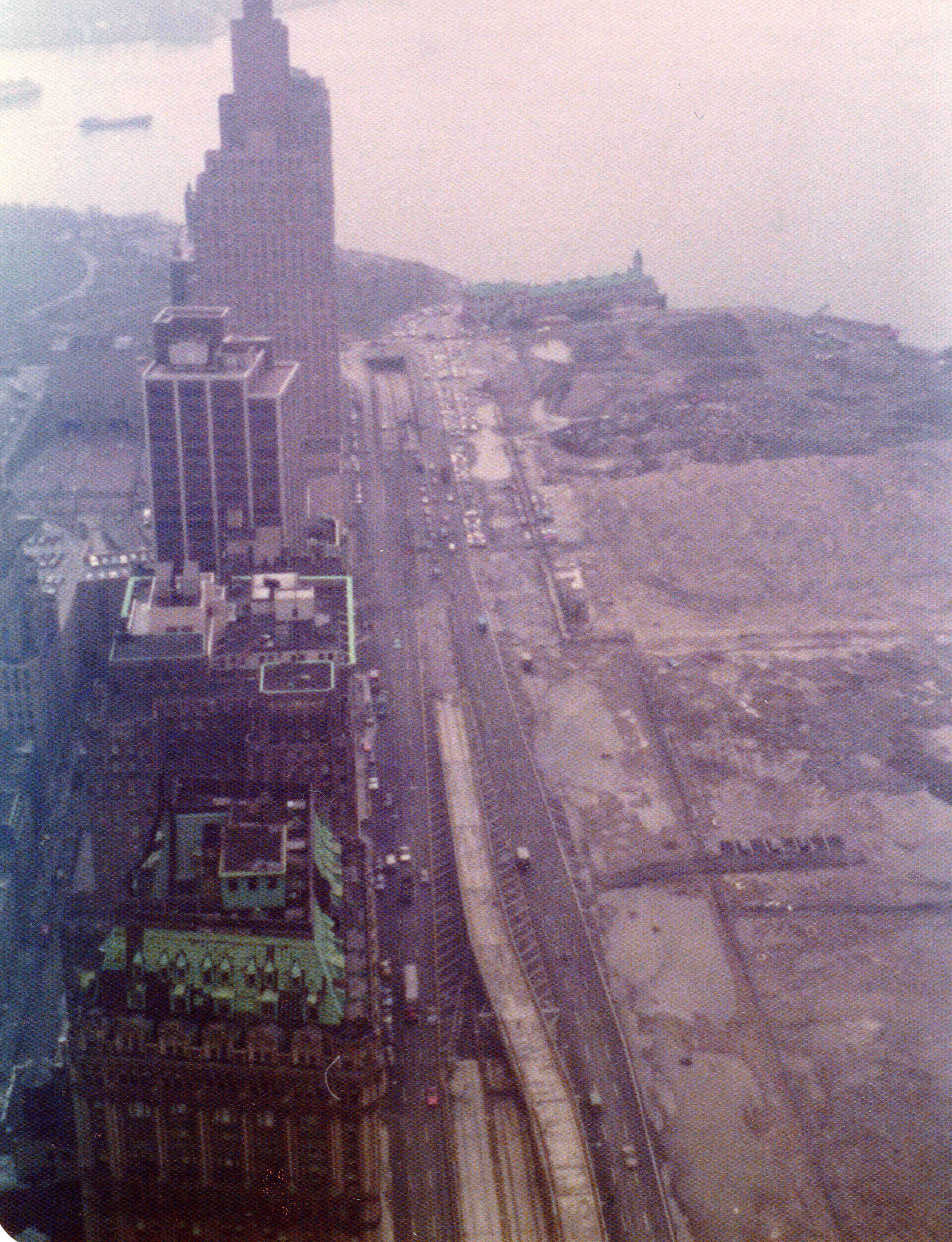 View from the 58th floor of the World Trade Center to the Battery Park City landfill, Pier A, end of the West Side Highway and New York Harbor on a foggy afternoon in March 1975. New York
