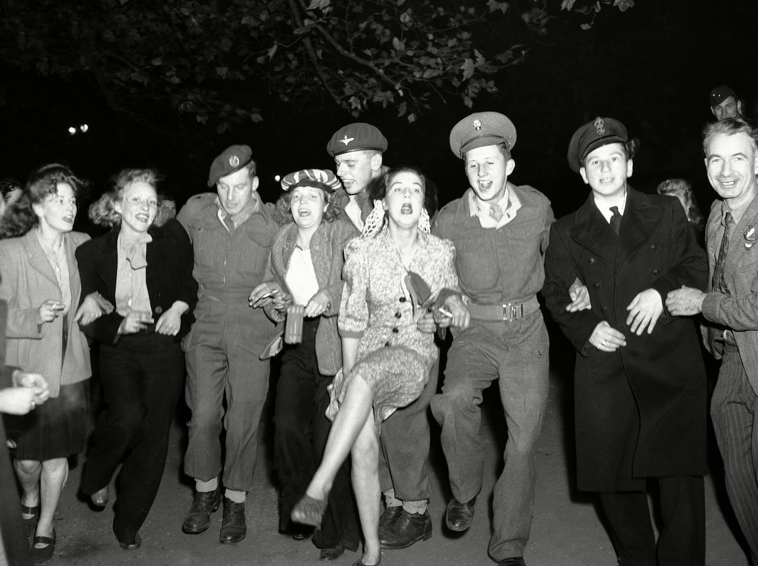 A troupe of happy soldiers and civilians enjoy the old fashion knees up as they celebrated VJ Day in the early hours of, in Piccadilly Circus in London WWII London VJ Celebrations, London.15 Aug 1945
