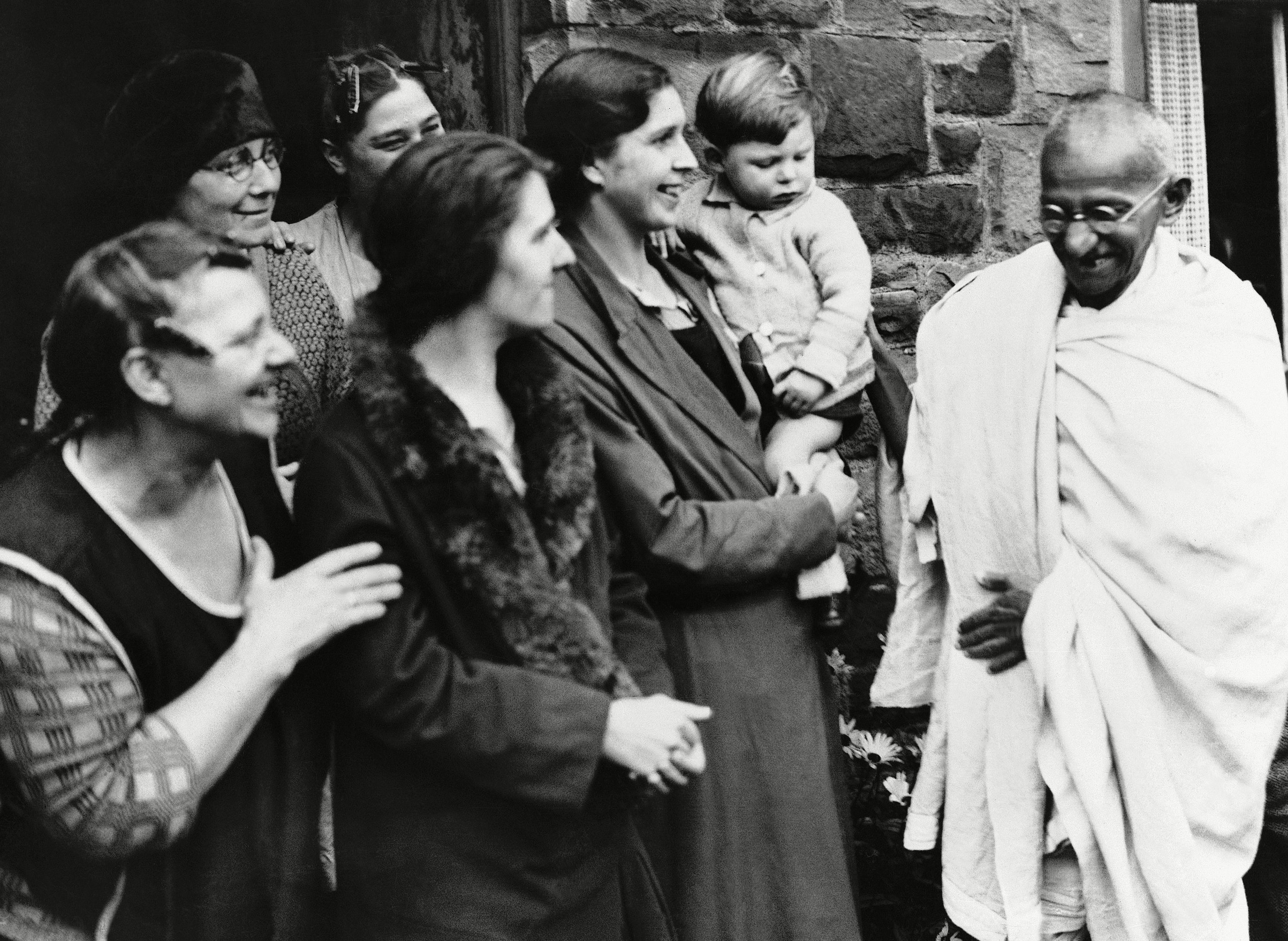 Gandhi visiting the workers in their cottages at Spring Vale, England, during his inspection of the Lancashire Cotton industry's labour conditions