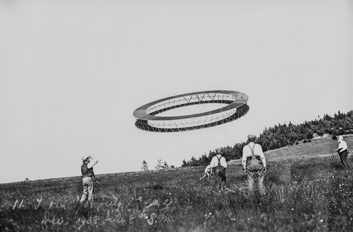 July 7, 1908 Alexander Graham Bell (right) and his assistants observe the flight of a circular tetrahedral kite.