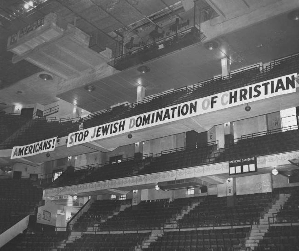 A banner with an anti-Jewish slogan is displayed at Madison Square, New York, February 20, 1939, shortly before adherents of the German American Bund, an organization largely financed by the government of Nazi Germany, began marching in for a rally.