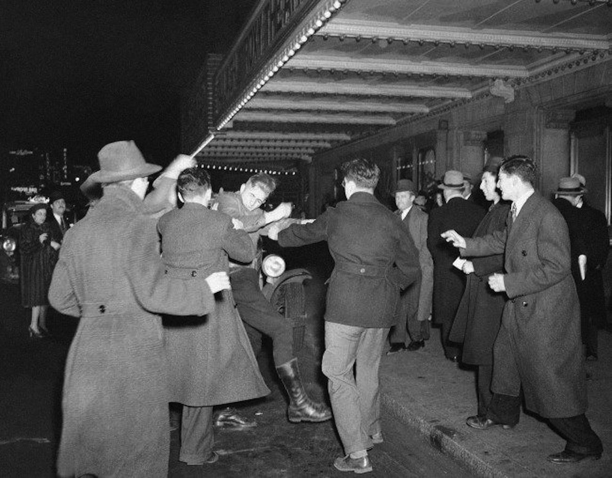 A crowd of demonstrators outside New York's Madison Square Garden on Feb. 20, 1939, seize a uniformed member of the German American Bund who had emerged from a Bund rally in the Garden and attempted to enter a taxi. Previously, inside the arena, Nazis had beaten a man who jumped onto the stage and approached Bund Leader Fritz Kuhn.