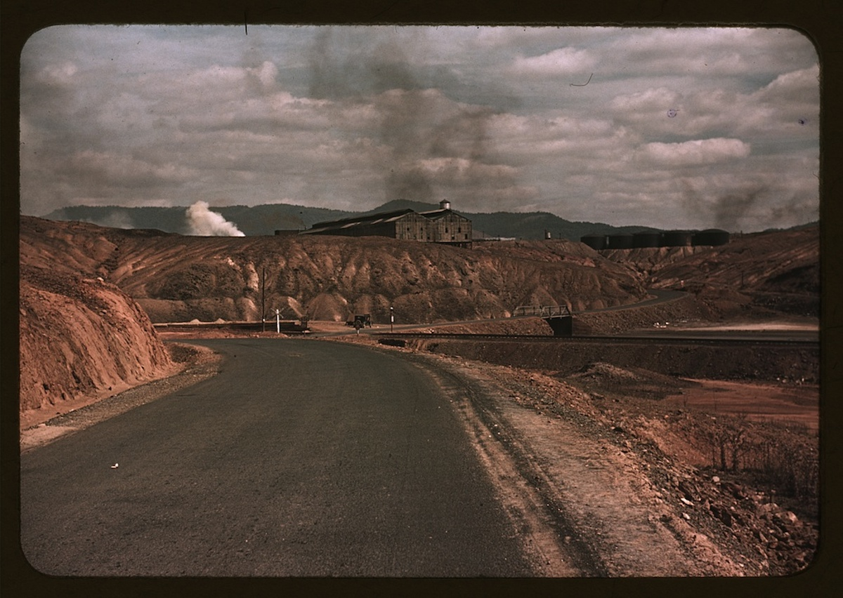 A train bringing copper ore out of the mine, Ducktown, Tenn. Fumes from smelting copper for sulfuric acid have destroyed all vegetation and eroded the land 1 slide : color. Contributor: Wolcott, Marion Post Date: 1939
