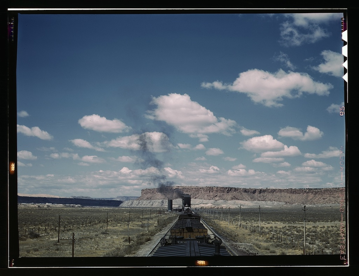 Santa Fe R.R. train stopping for coal and water, Laguna, N[ew] Mex[ico] 1 transparency : color. Contributor: Delano, Jack Date: 1939