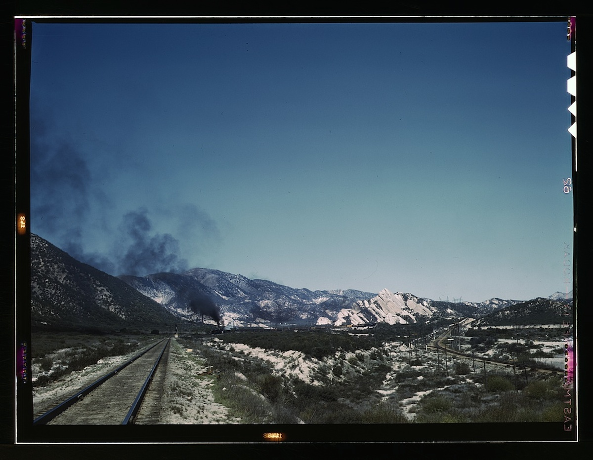 Freight train going up Cajon Pass through the San Bernardino Mountains, Cajon, Calif. 1 transparency : color. Contributor: Delano, Jack Date: 1939