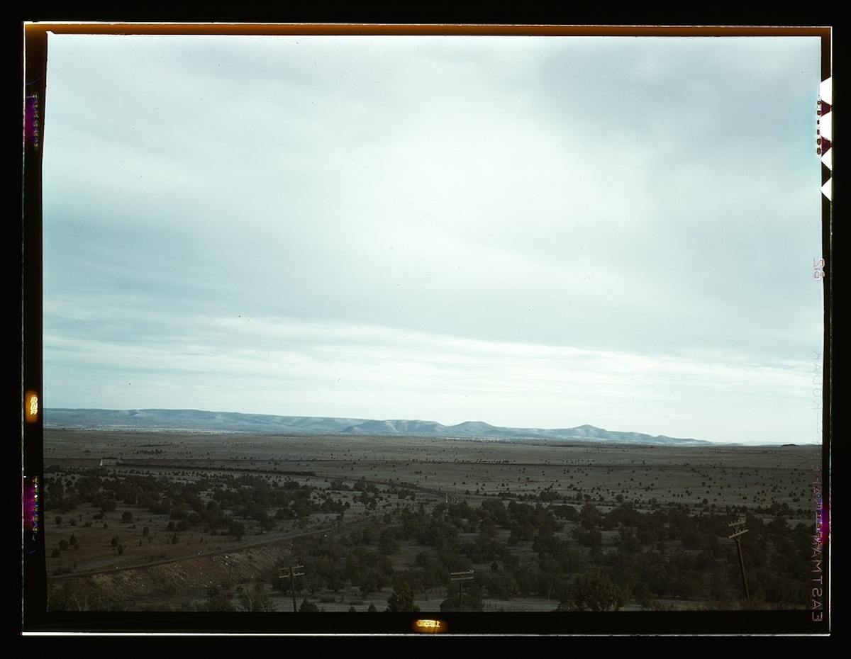 Santa Fe R.R. freight train rounding a curve between Ash Fork and Gleed, Arizona 1 transparency : color. Contributor: Delano, Jack Date: 1939