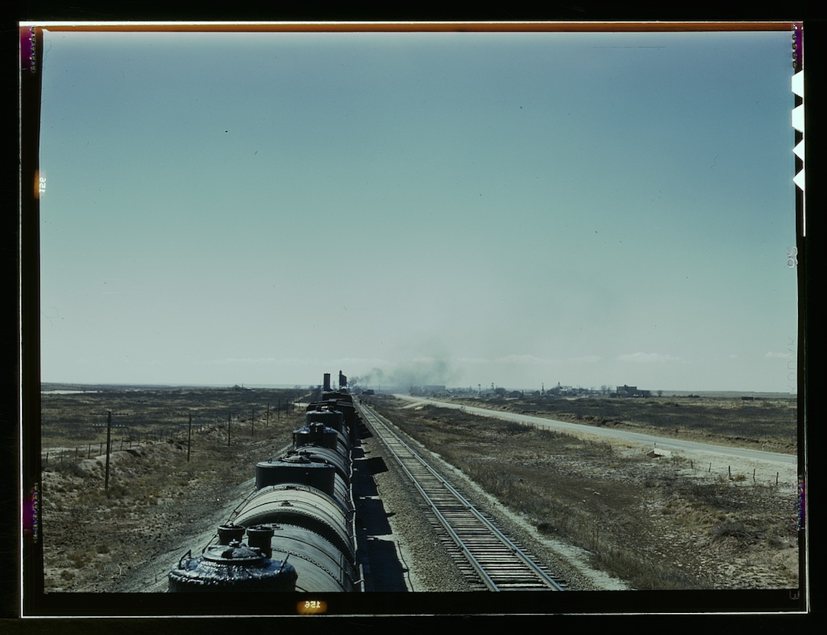 West bound Santa Fe R.R. freight train stopping for water, Tolar, N[ew] Mex[ico] 1 transparency : color. Contributor: Delano, Jack Date: 1939