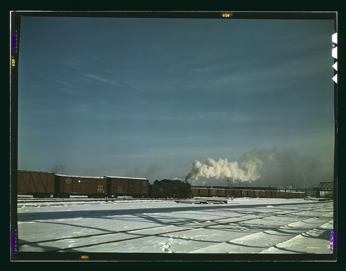 A train pulling out of the freight house at C & NW RR's Proviso(?) yard, Chicago, Ill. 1 transparency : color. Contributor: Delano, Jack Date: 1939