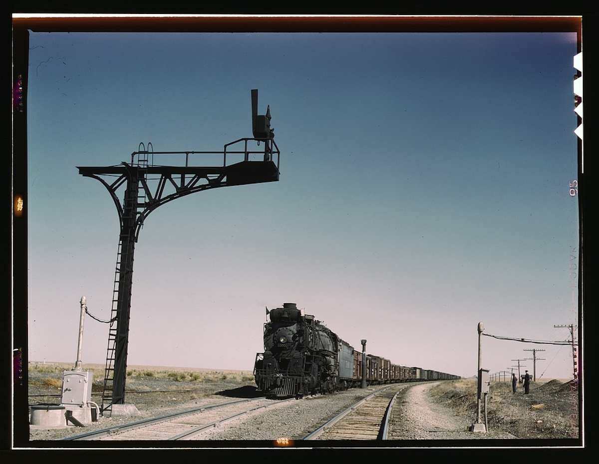 West bound Santa Fe R.R. freight train waiting in a siding to meet an east bound train, Ricardo, N[ew] Mex[ico] 1 transparency : color. Contributor: Delano, Jack Date: 1939