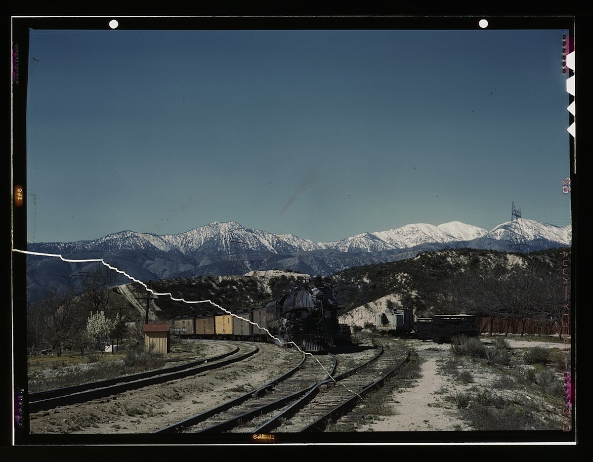 A east bound Union Pacific railroad freight train waiting in a siding, Alray, Calif. Coming up through Cajon Pass. The Santa Fe tracks are used by the Union Pacific as far east ... 1 transparency : color. Contributor: Delano, Jack Date: 1939