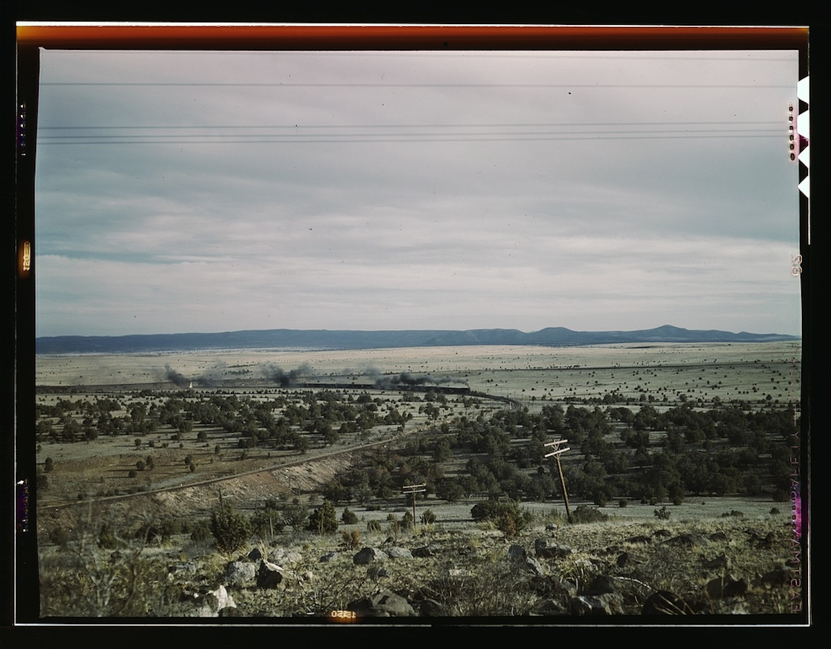 West-bound passenger train going around a curve on the Atchison, Topeka, and Santa Fe railroad between Winslow and Seligman, Arizona, [near] Gleed, Arizone 1 transparency : color. Contributor: Delano, Jack Date: 1939