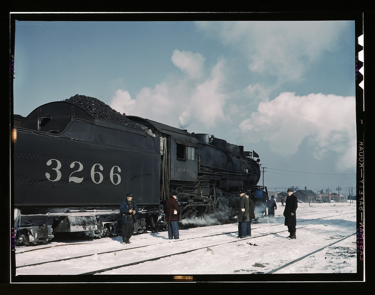Santa Fe RR freight train about to leave for the West Coast from Corwith yard, Chicago, Ill., Santa Fe R.R. trip 1 transparency : color. Contributor: Delano, Jack Date: 1939