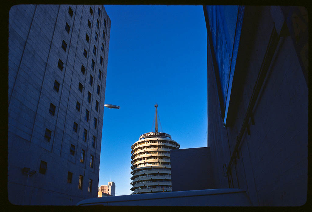 The Capitol records building at Hollywood and Vine with Goodyear Blimp