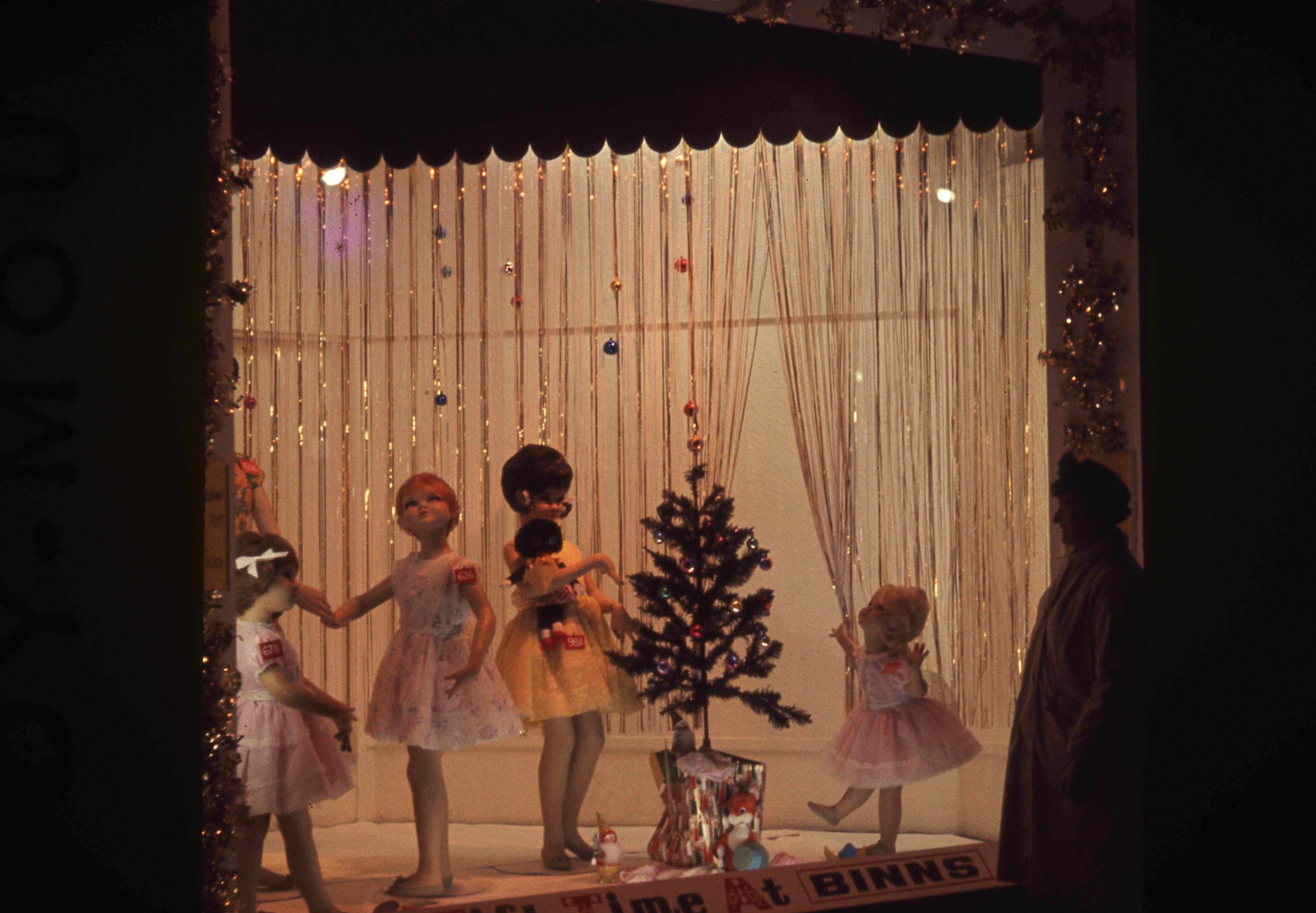 This photograph shows the festive window of Binns department store in Newcastle upon Tyne. This is a 35mm slide. It was taken in 1963.