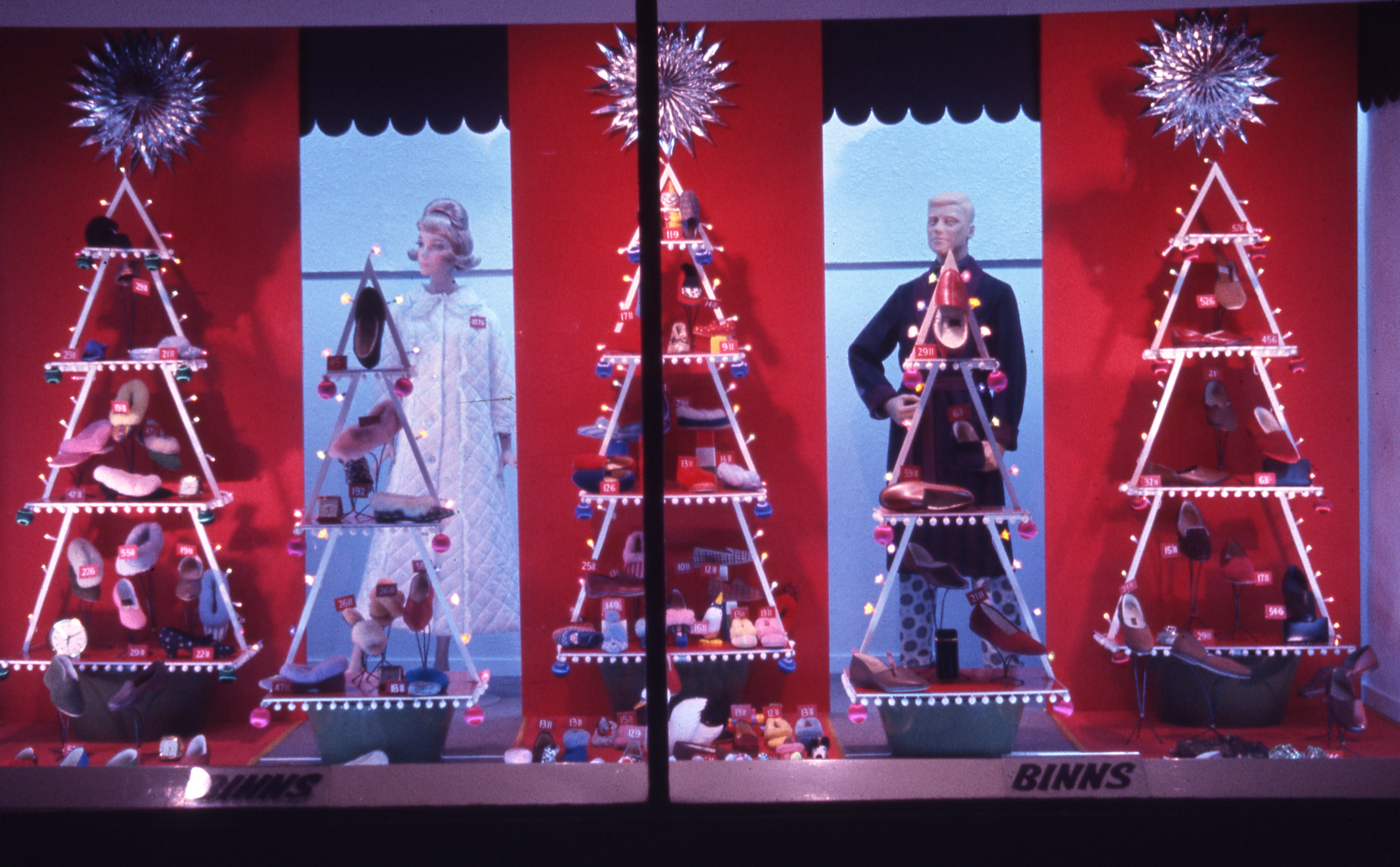 This is a night time view of Binns department store Christmas window in Newcastle upon Tyne. This is a 35mm slide. It was taken in 1965.