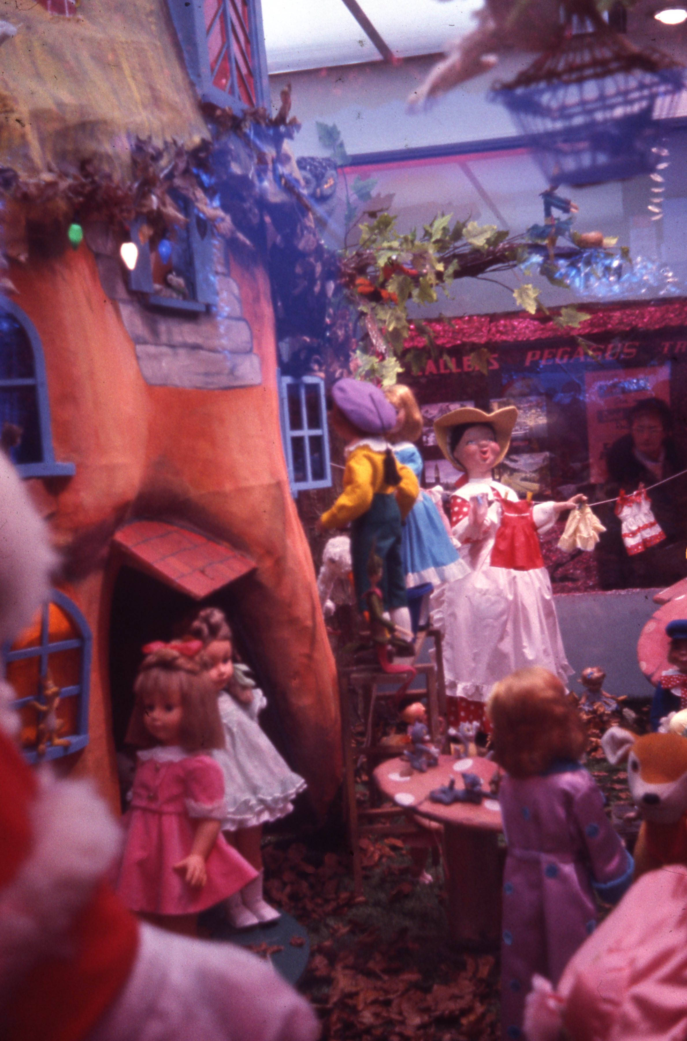Featuring 'The old woman who lived in a shoe.' this is a festive display for children at Callers department store in Newcastle upon Tyne. This is a 35mm slide. It was taken in 1965.