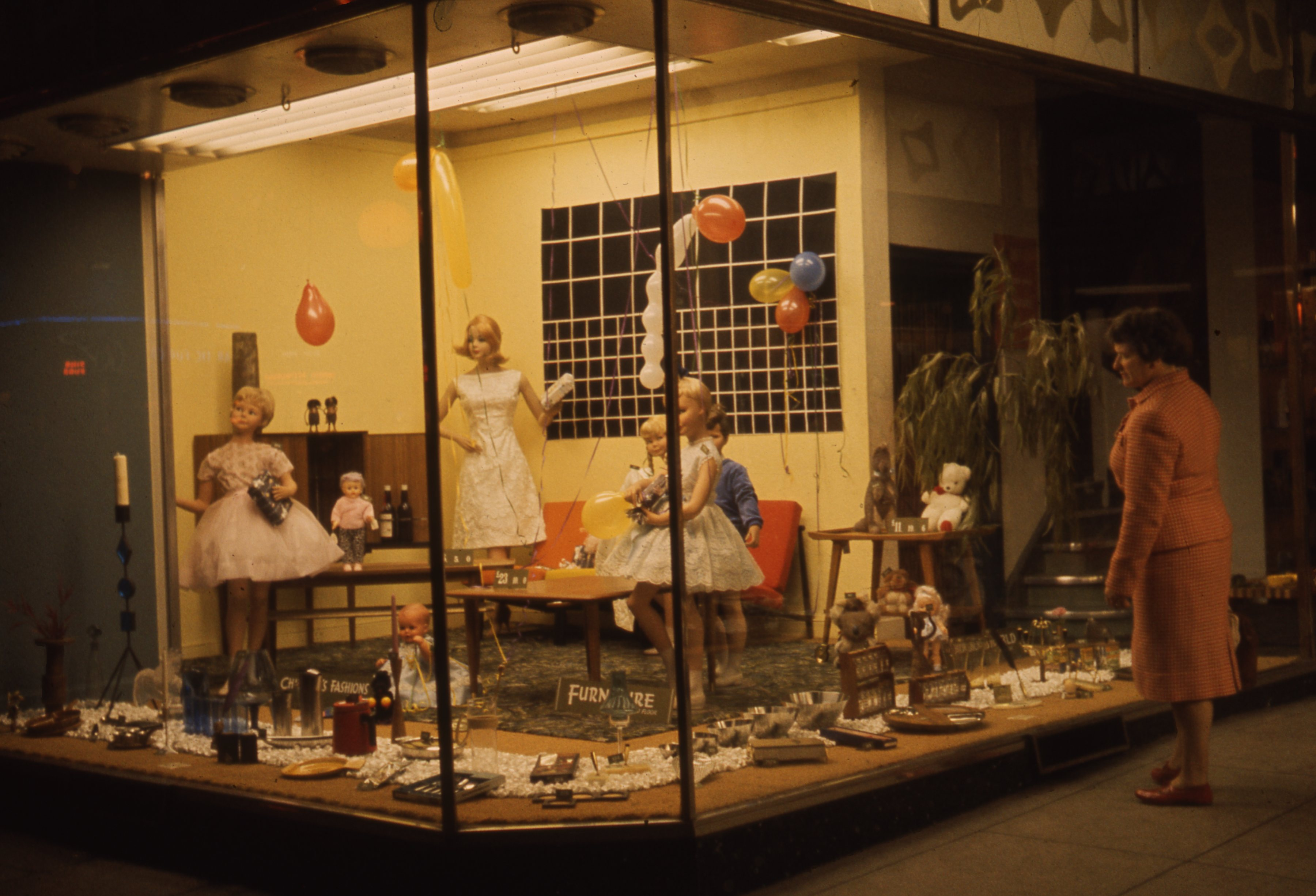 This is a festive window of the Broadloom Mill shop in Grey Street, Newcastle upon Tyne. This is a 35mm slide. It was taken in 1962.