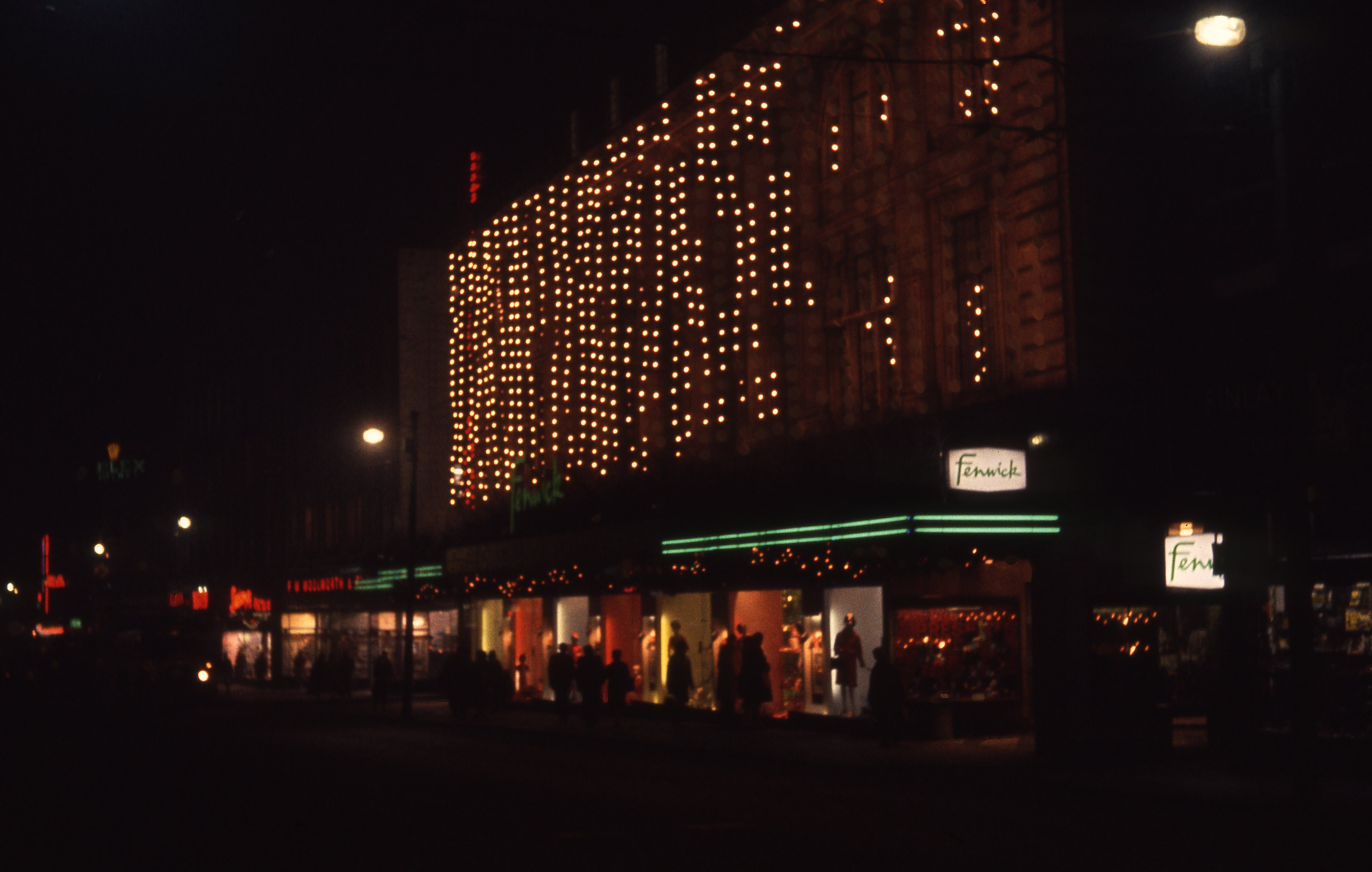 It shows the festive lights of Fenwicks department store in Newcastle upon Tyne. This is a 35mm slide. It was taken in 1964.