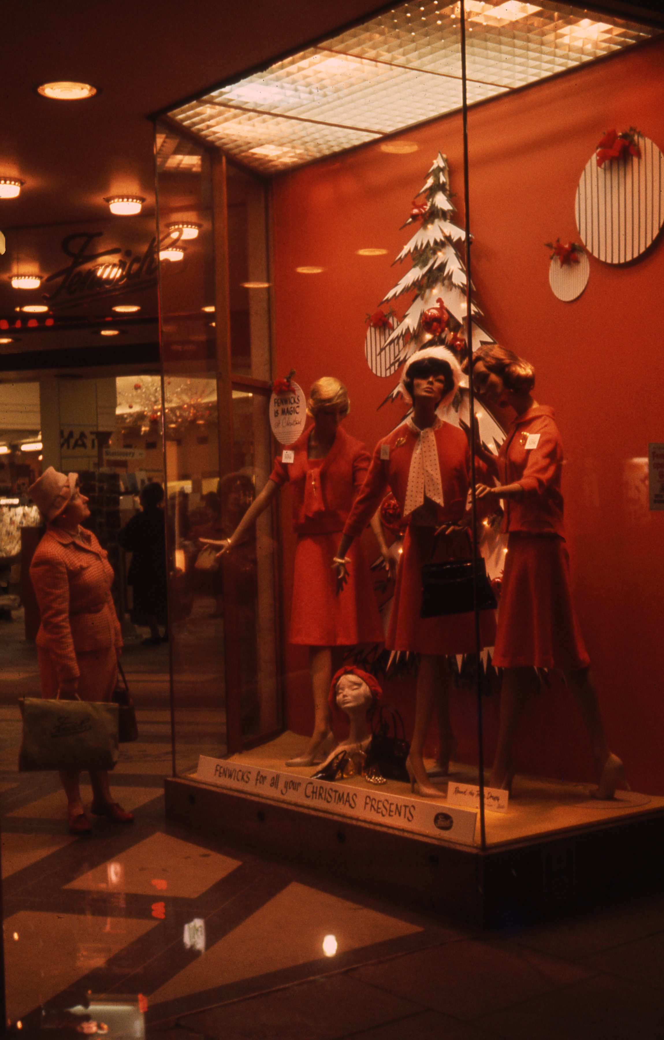 This photograph shows the display for 'Fenwicks, for all your Christmas presents.' in Fenwicks department store in Newcastle upon Tyne. This is a 35mm slide. It was taken in 1962.