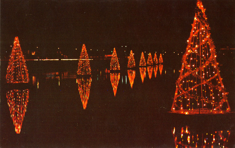 Trees Belmont Shore, Long Beach, CA Long Beach, California. Christmas Eve on Belmont Shore. Brightly lighted trees moored on barges cast dazzling reflections on the still waters of Alamitos Bay, while carols from boatloads of choirs sound clear upon the quiet night.
