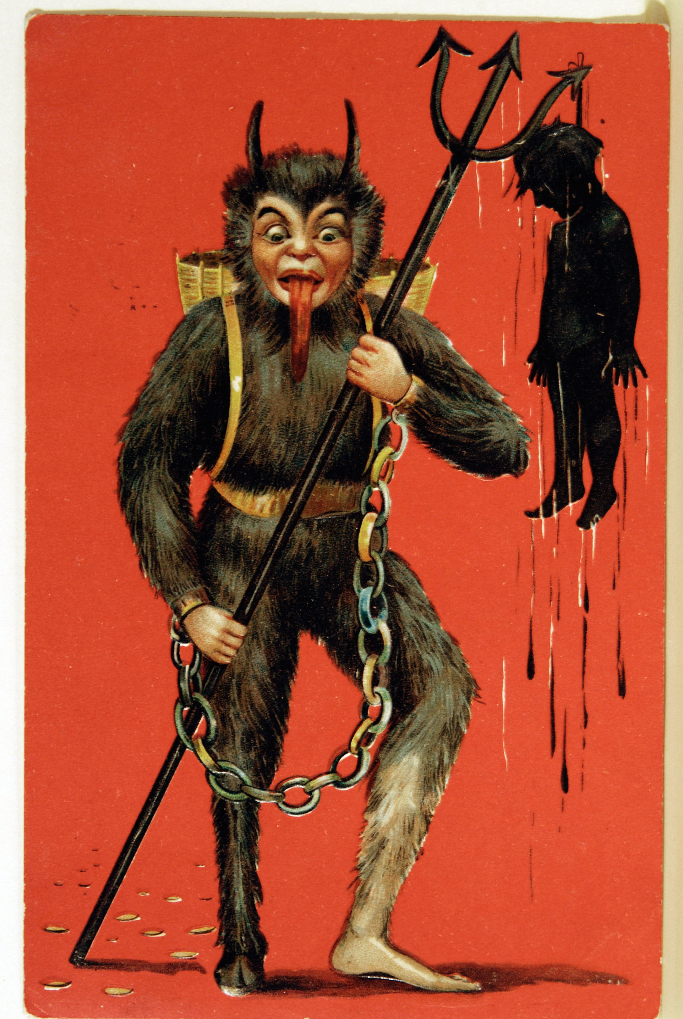 Krampus or Pere Fouettard (Knecht Ruprecht) flourishing a child at the end of his pitchfork. Postcard, Hungary 1906