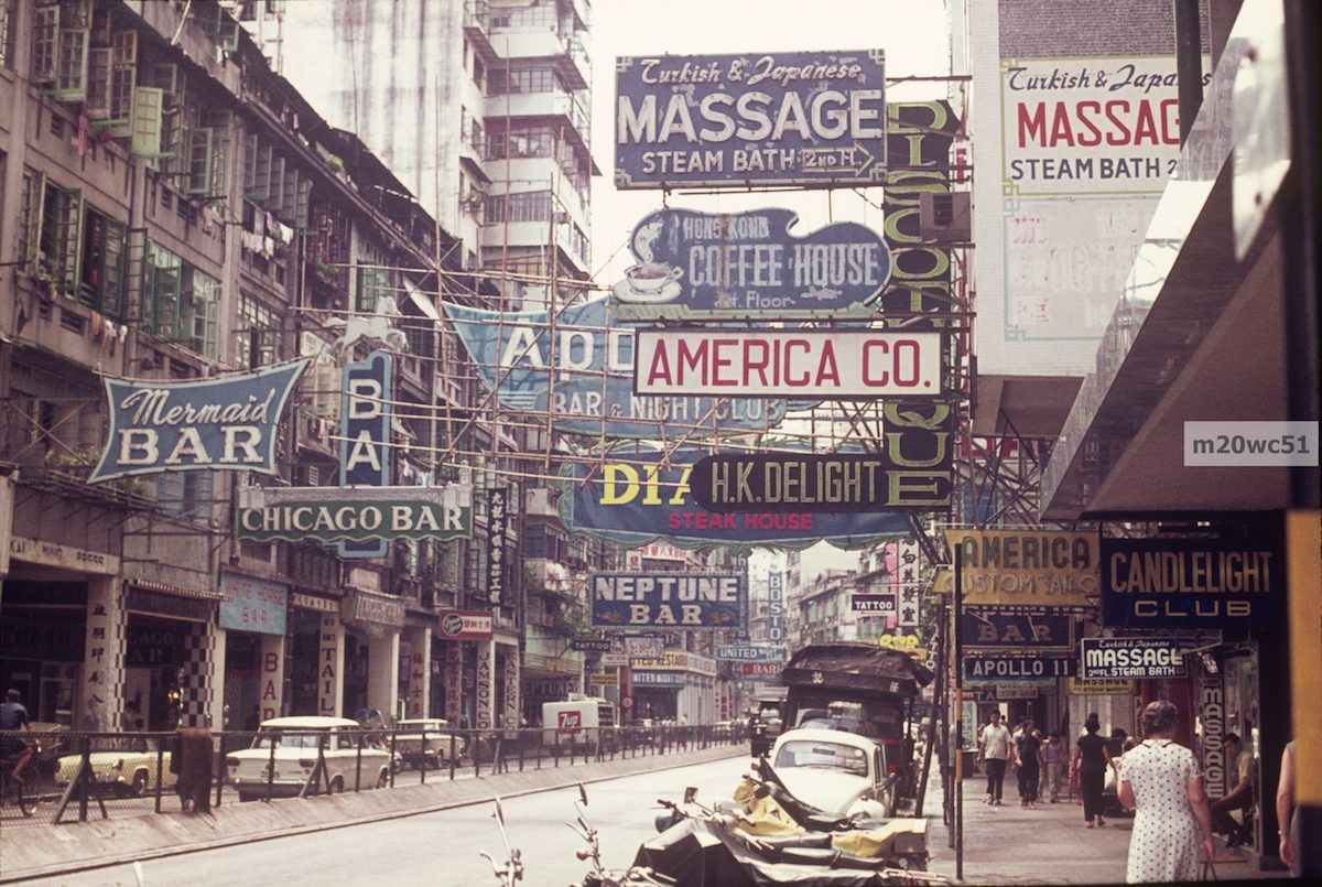 "Lockhart Road, circa 1970. I think this is perhaps the very best photo of Wanchai in the ""American R&R"" period that I am aware of (other than one or two that I took-LOL). The ""Candlelight"" bar was at 42-50 Lockhart Road, so this photographer must have been standing in front of the ""Pussycat"" bar (34-38 Lockhart)"