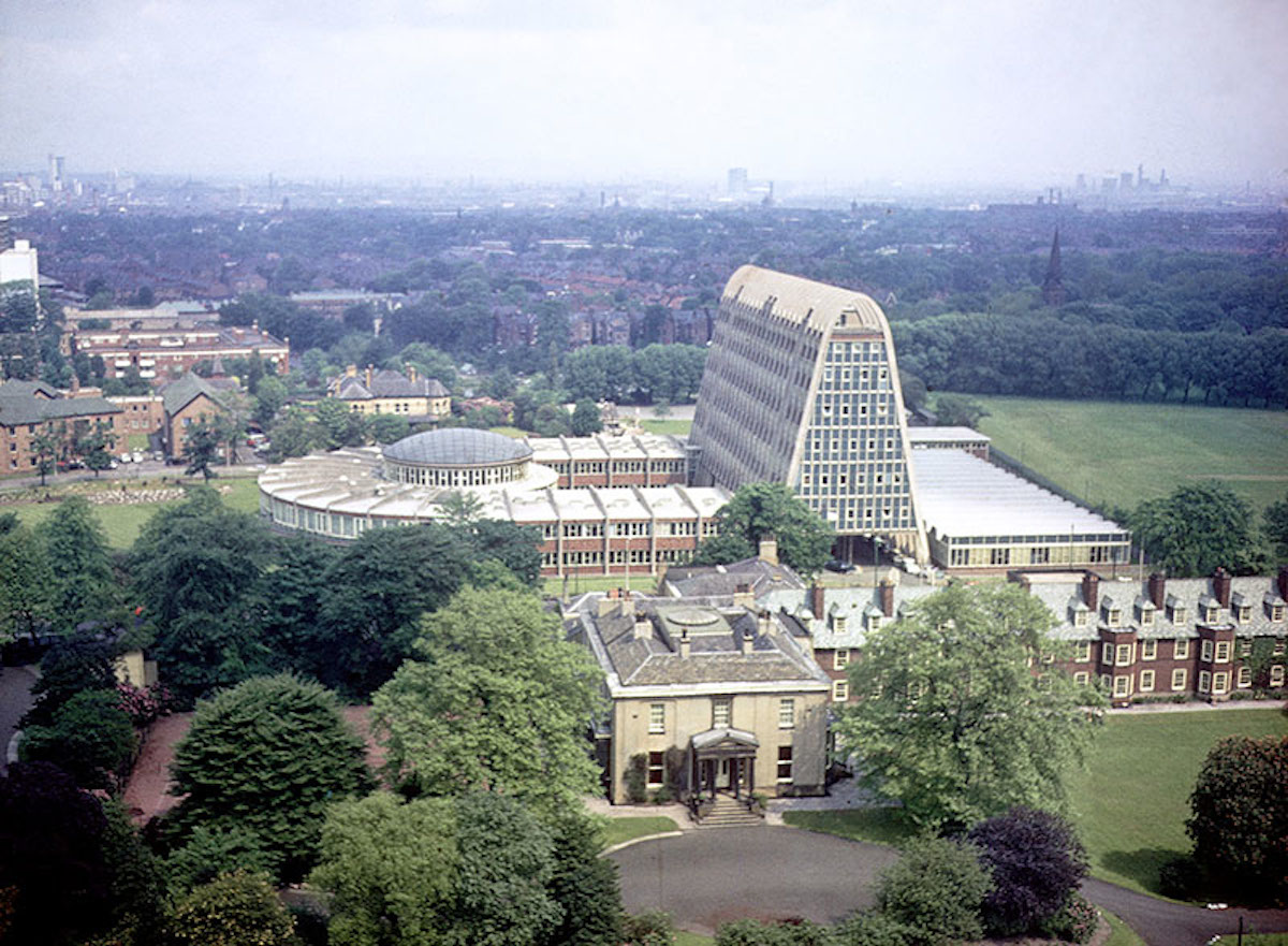 View of Hollings Building from the tower of Owen's Park student residences in 1967. Originally built for Hollings College (formerly the Domestic and Trades College) in 1957-60, and designed by the city architect, L. C. Howitt. Ashburne Hall is in the foreground.