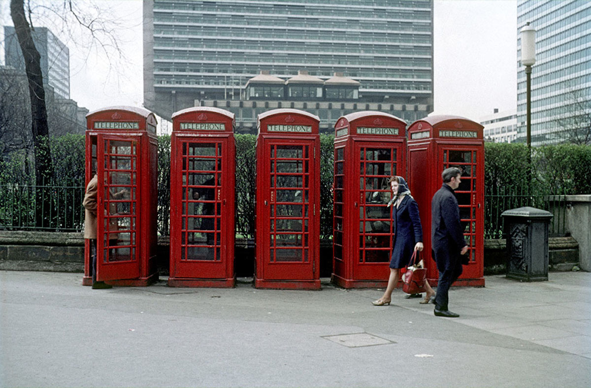 A group of five 'K6' public telephone boxes at the edge Piccadilly Gardens, Manchester, around 1969.